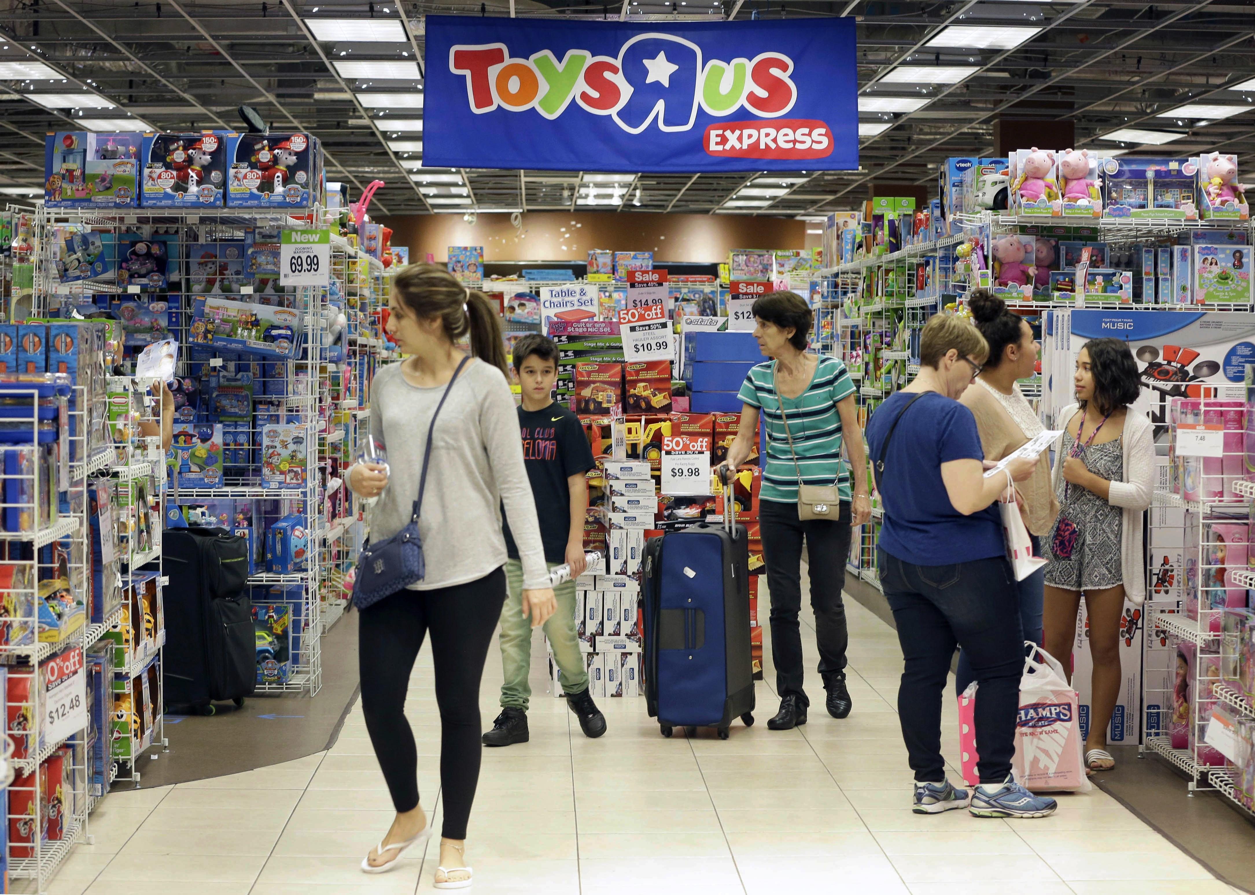 shoppers browse at a toys r us store in miami the national toy chain