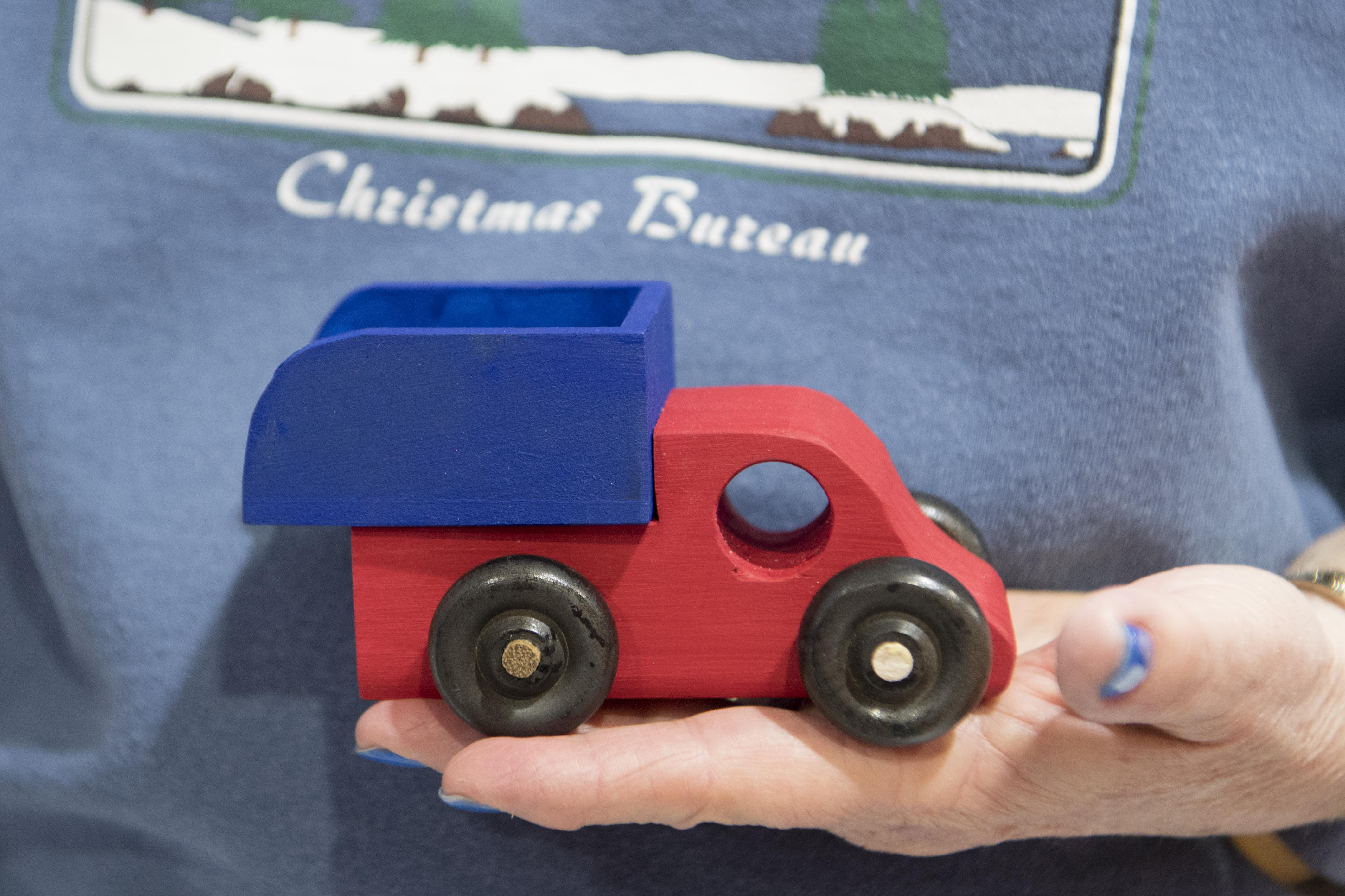 vets garage on a mission to build wooden toy trucks for the