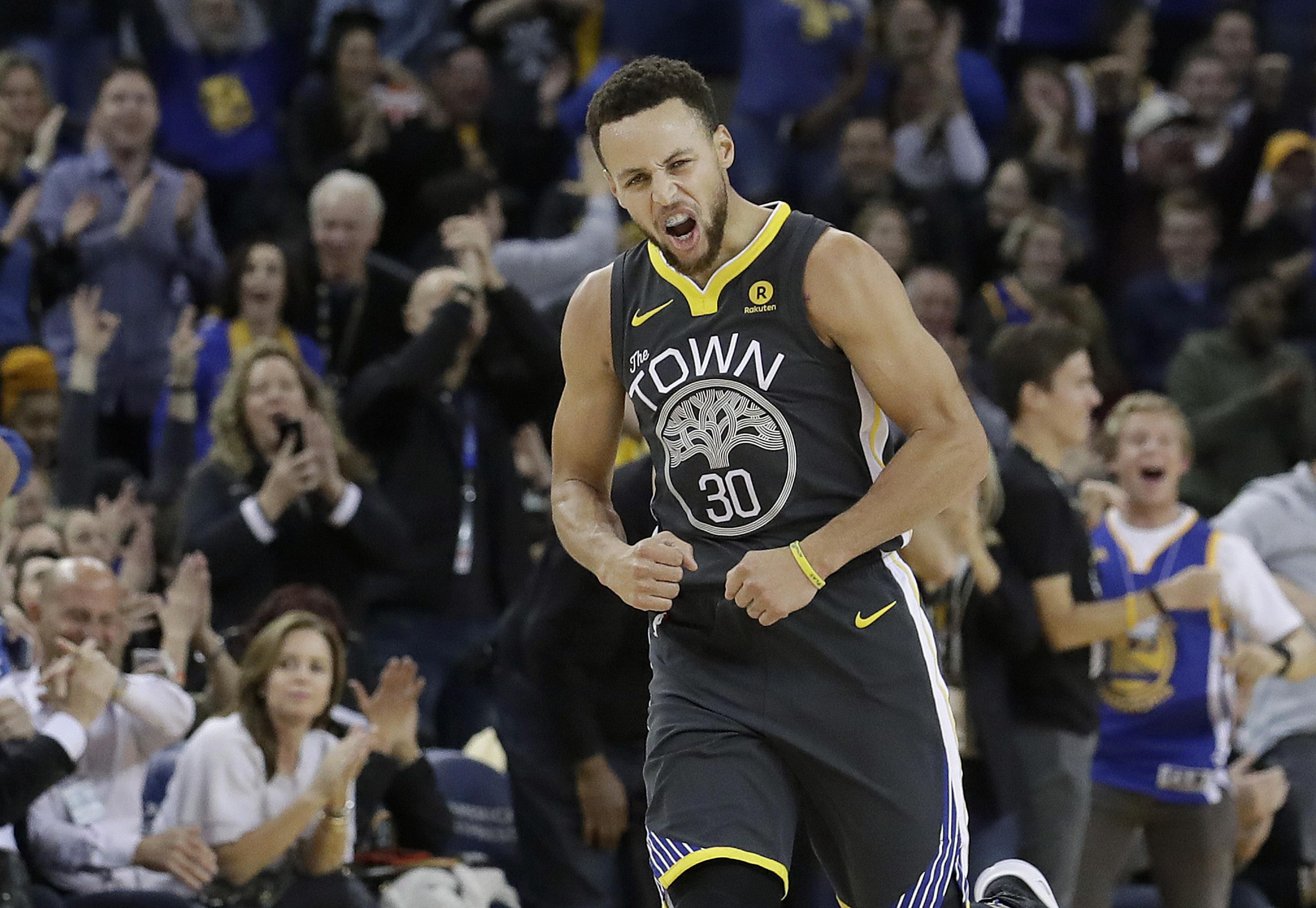 1a8aa855547 Golden State Warriors guard Stephen Curry reacts after scoring during the  first half against the Memphis