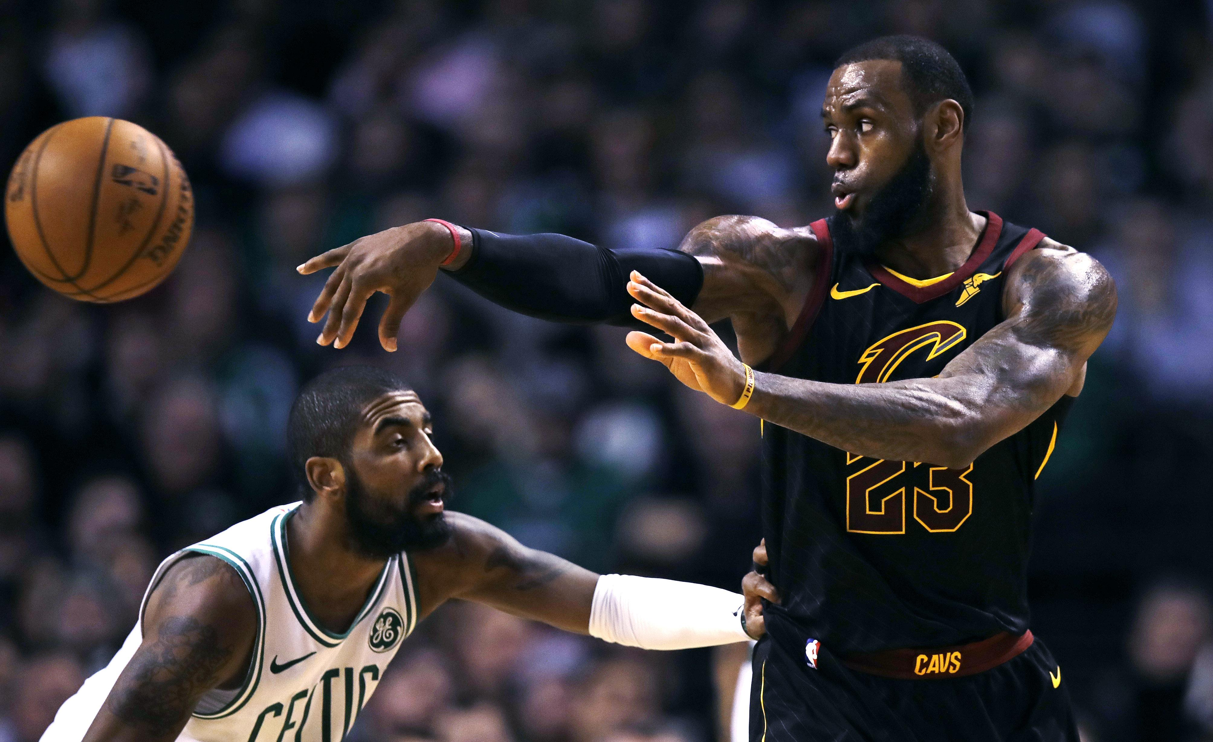 f157ffc82af1 Cleveland Cavaliers forward LeBron James (23) passes the ball as Boston  Celtics guard Kyrie