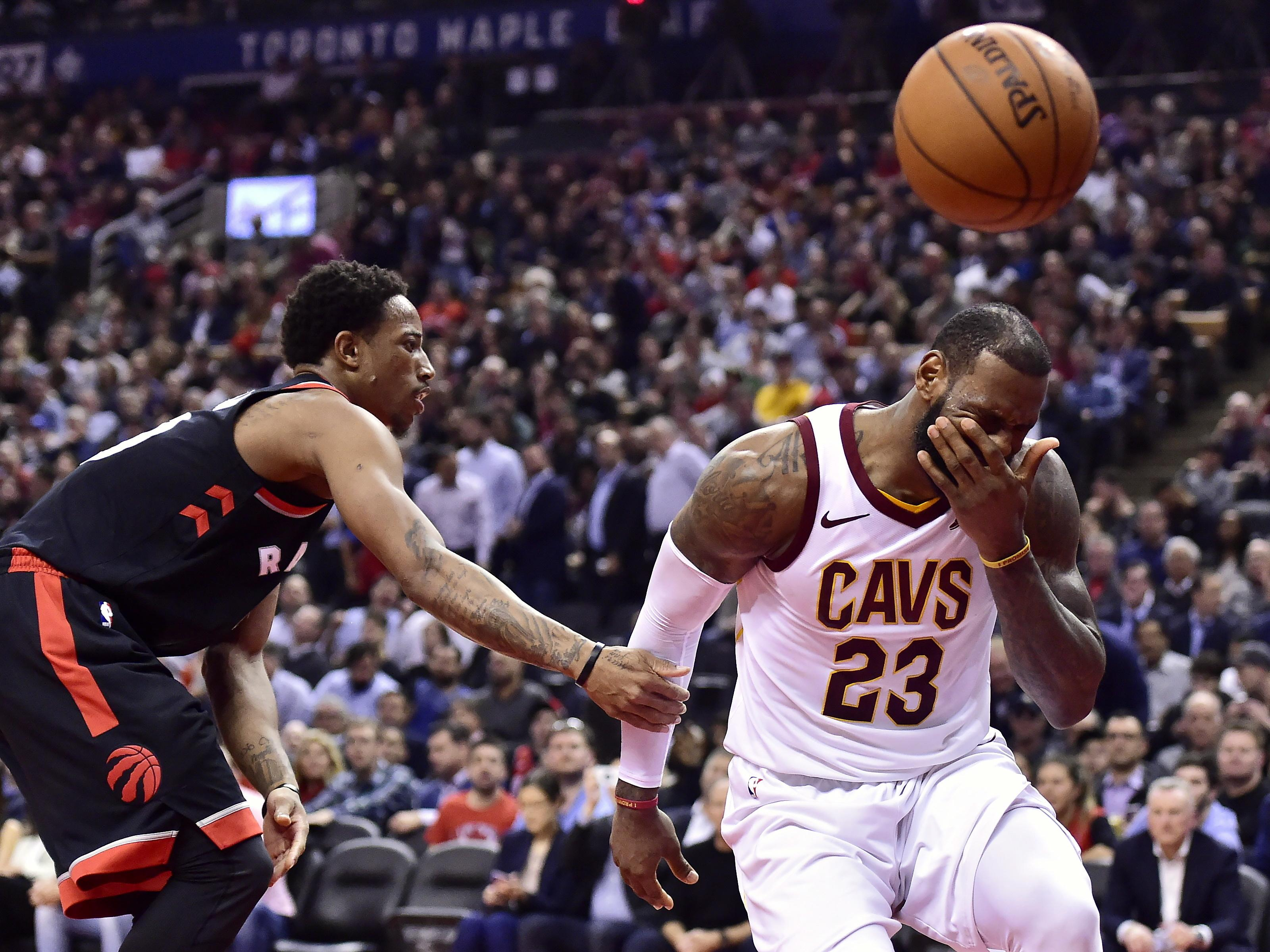 41658afb09d4 Cleveland Cavaliers forward LeBron James reacts after being fouled by  Toronto Raptors guard DeMar DeRozan