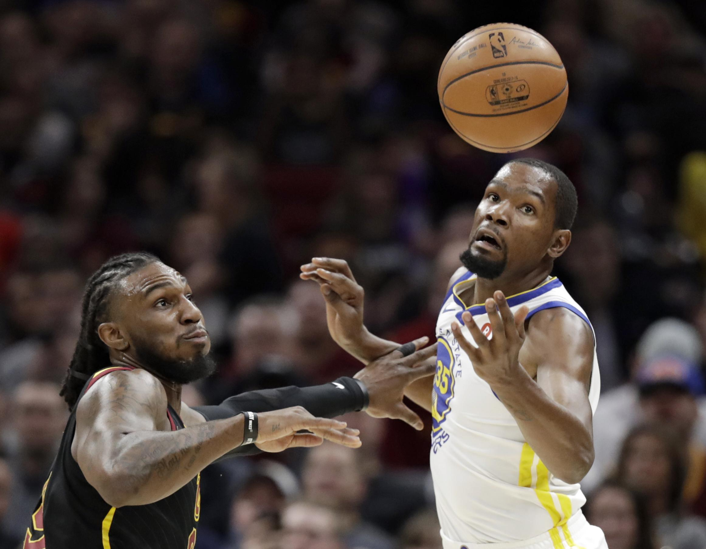Clevelands Jae Crowder left knocks the ball loose from Golden States Kevin Durant on