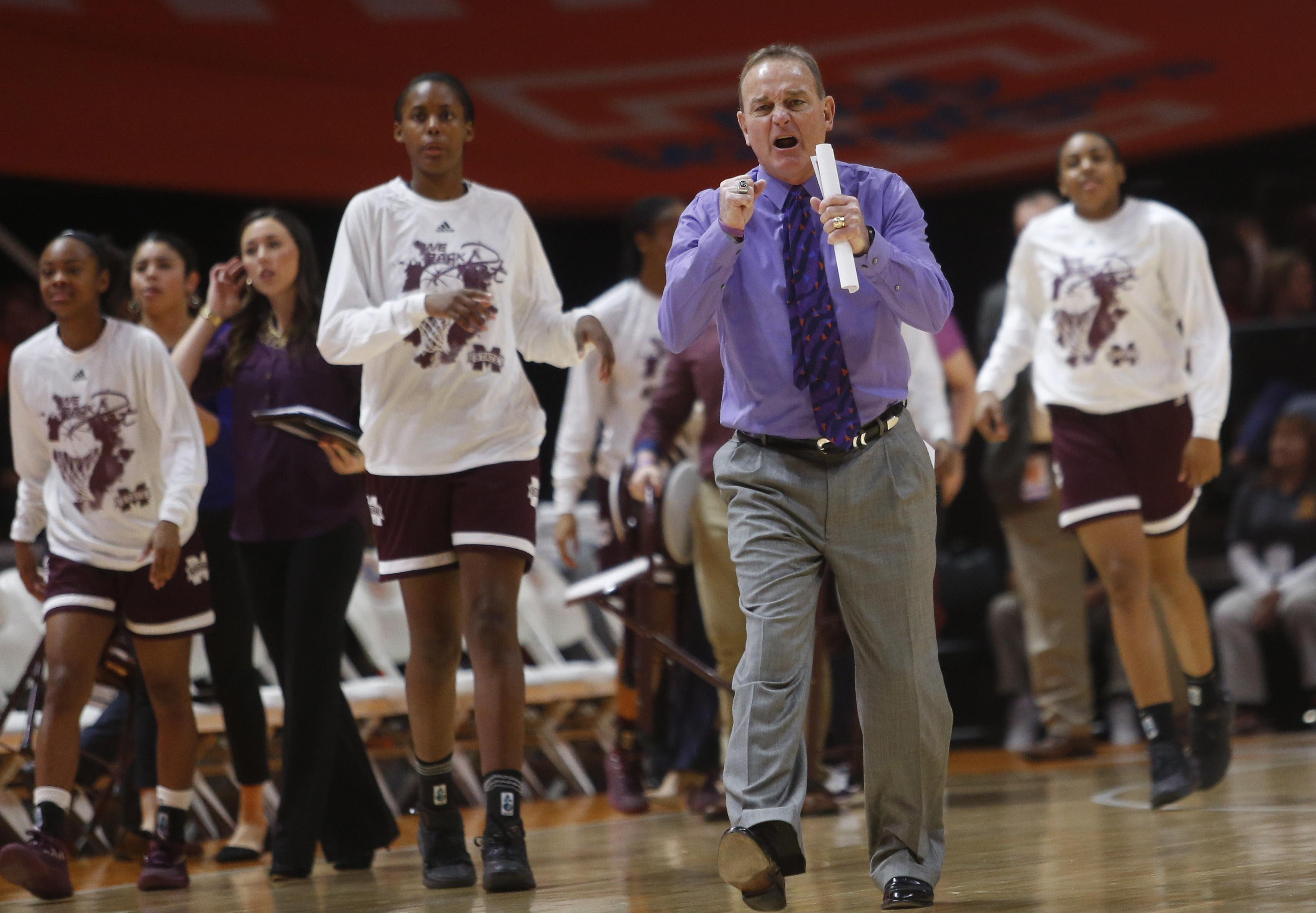 Mississippi State head coach Vic Schaefer congratulates his team as they  head toward the bench during