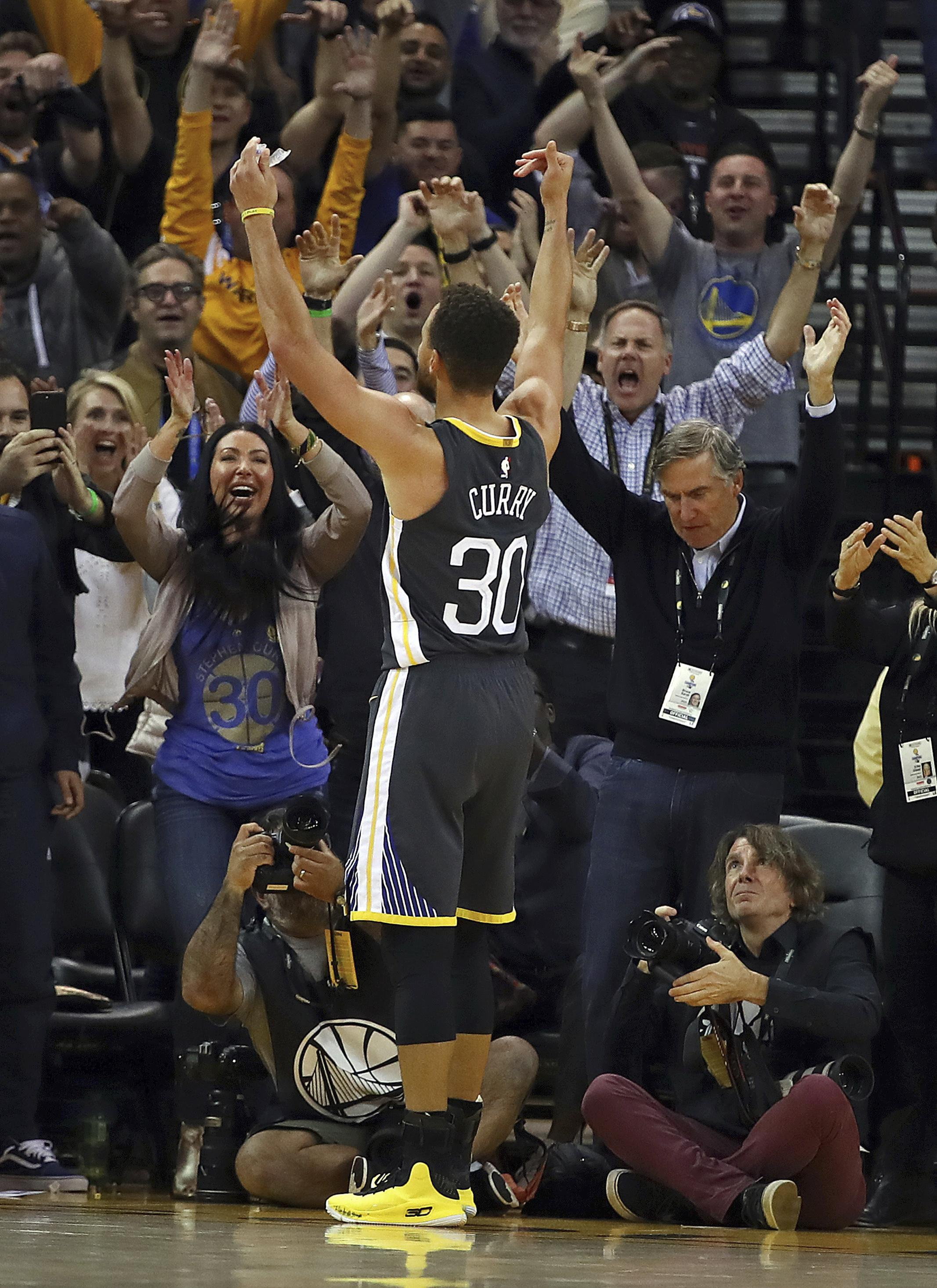 591f8f2b9e54 Golden State s Stephen Curry celebrates with fans after scoring two of his  season-high 49