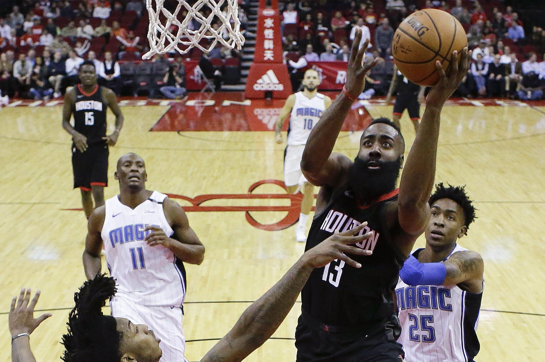 059e8f48f02c Houston Rockets guard James Harden drives to the basket as Orlando Magic  guard Elfrid Payton