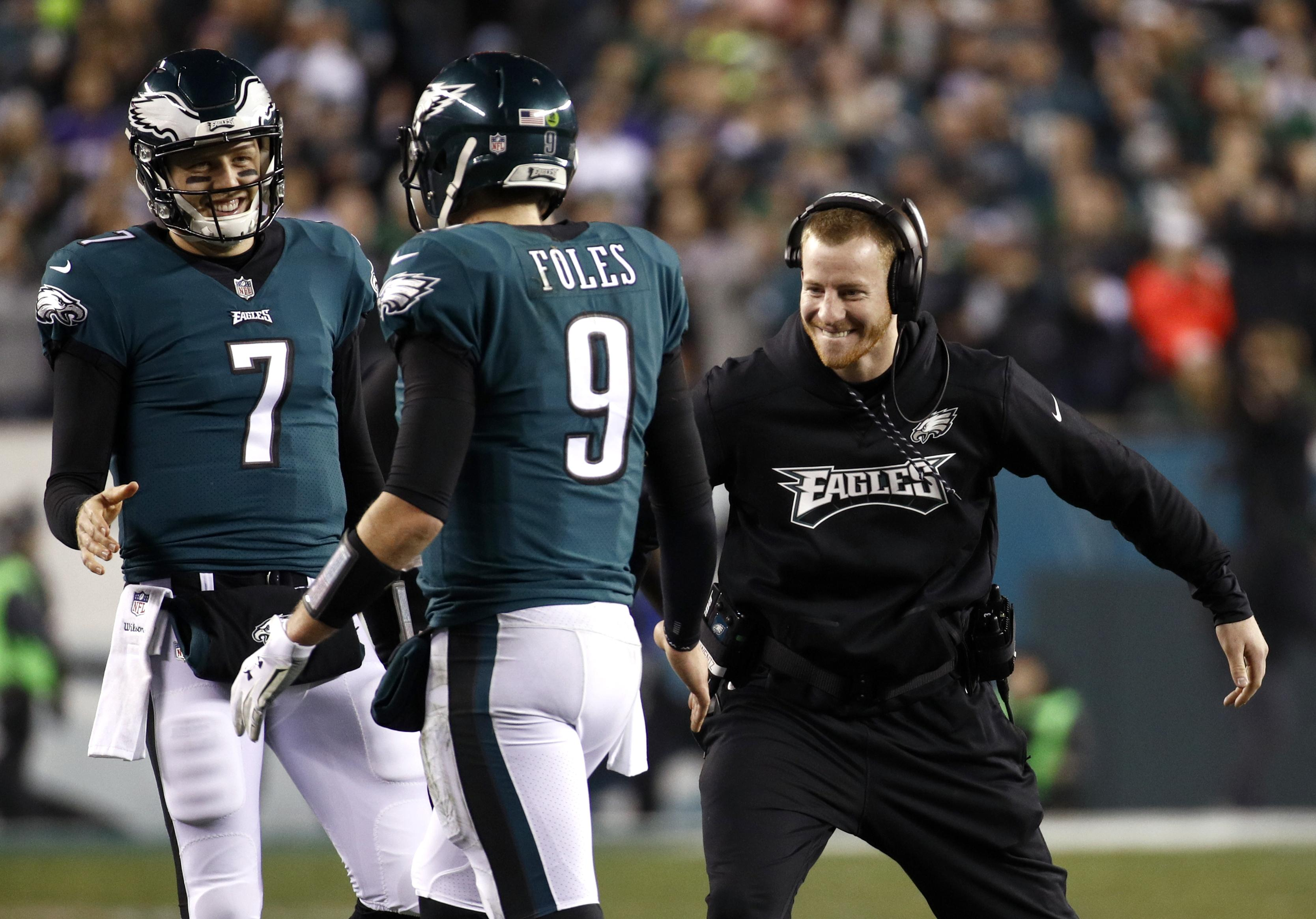 Philadelphia s Carson Wentz congratulates Nick Foles during the second half  of the Eagles  NFC championship 3a008ed8e