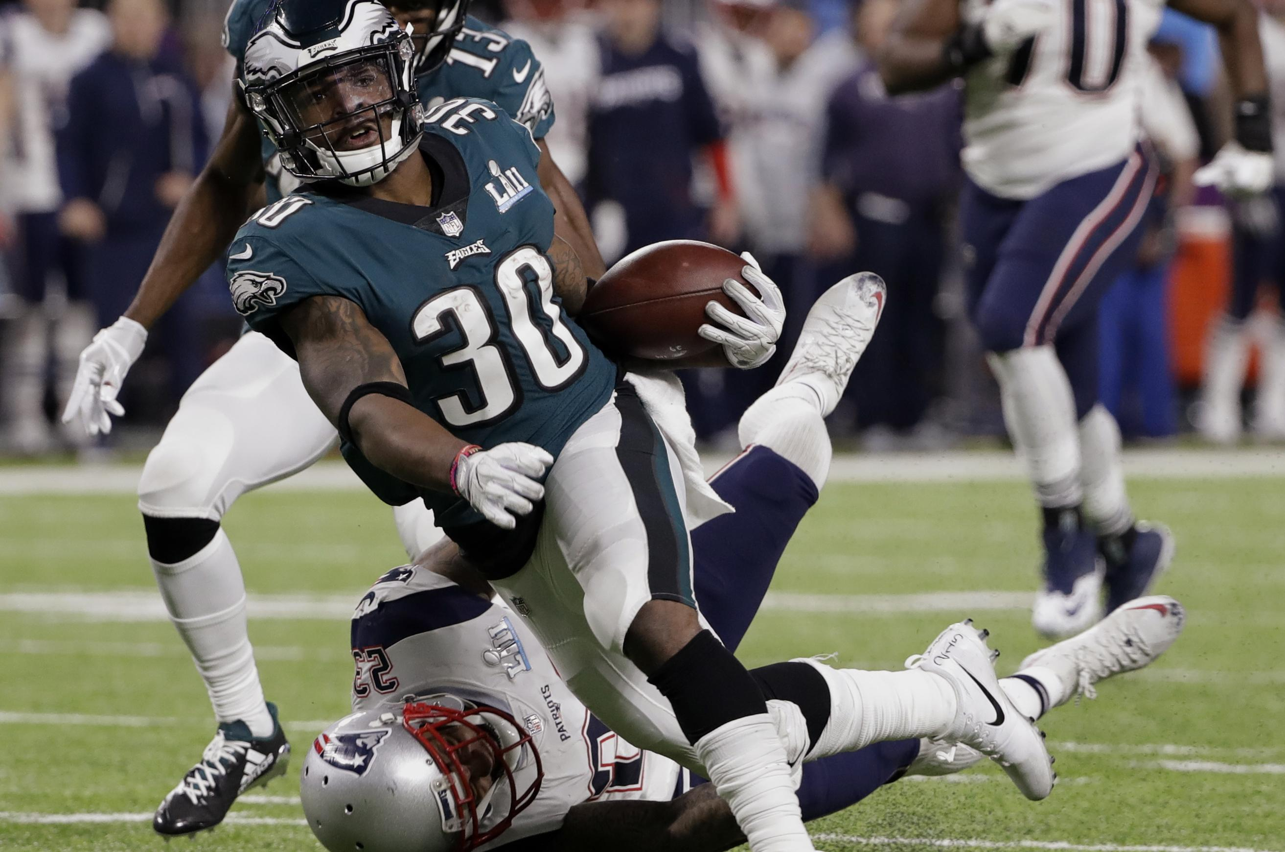 2c159bdbe Philadelphia Eagles running back Corey Clement is tackled by New England  Patriots strong safety Patrick Chung