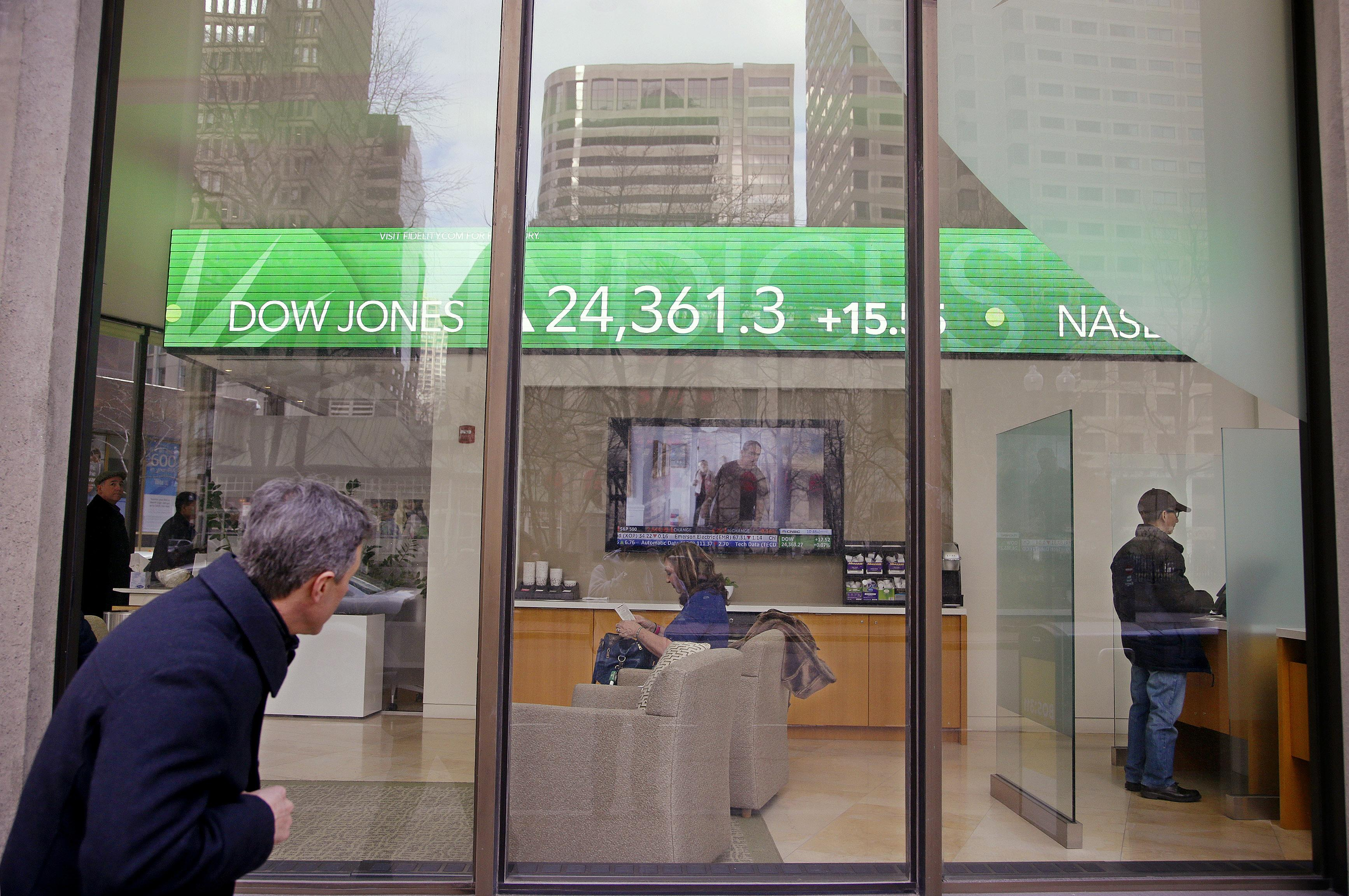 Perfect A Passer By Peers In The Window While Investors Congregate Feb. 6, 2018
