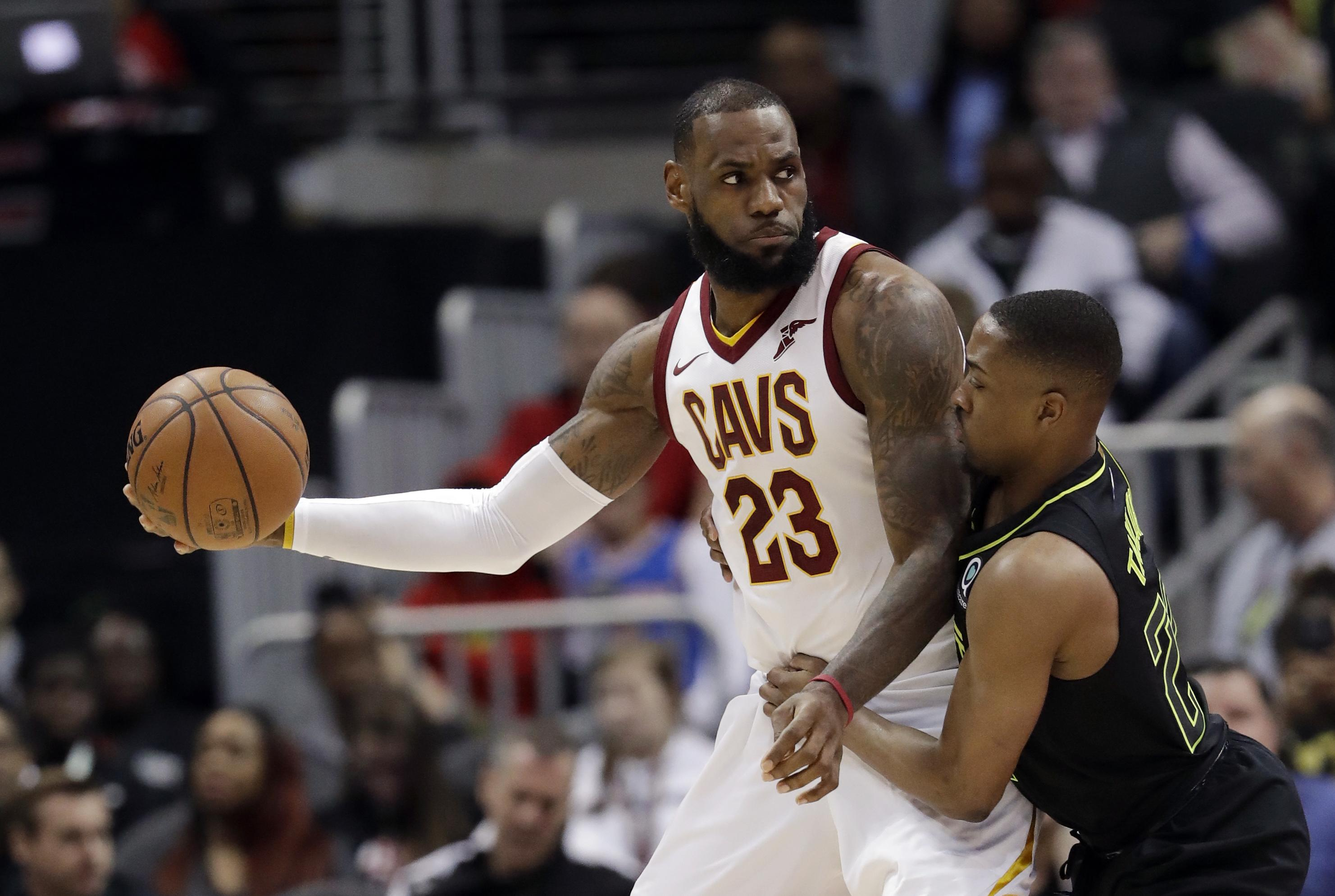 6e5dc46c2db Cleveland Cavaliers forward LeBron James (23) works against Atlanta Hawks  guard Isaiah Taylor (