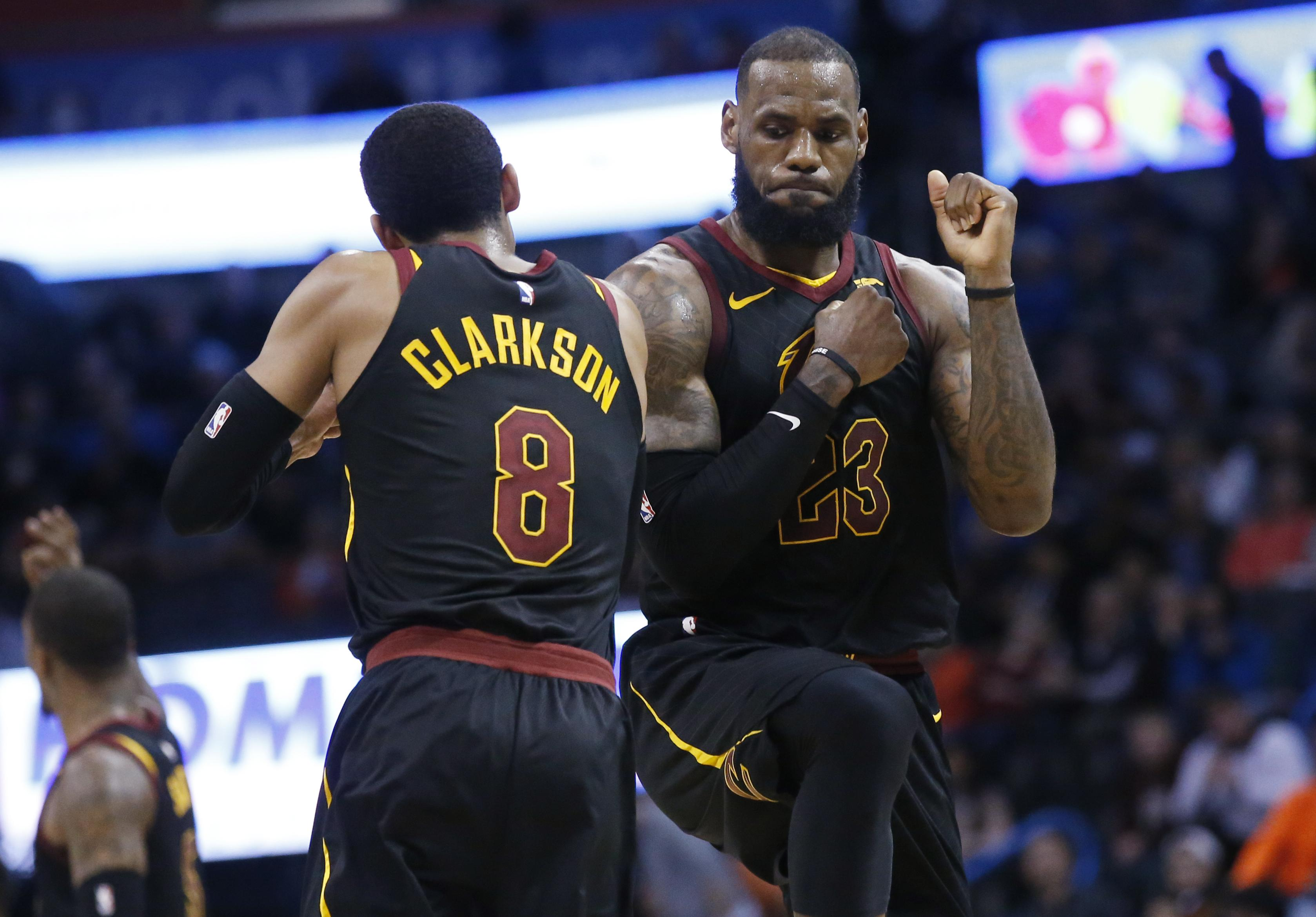 68c78dc628ae Cleveland Cavaliers forward LeBron James (23) celebrates with teammate  Jordan Clarkson during the second