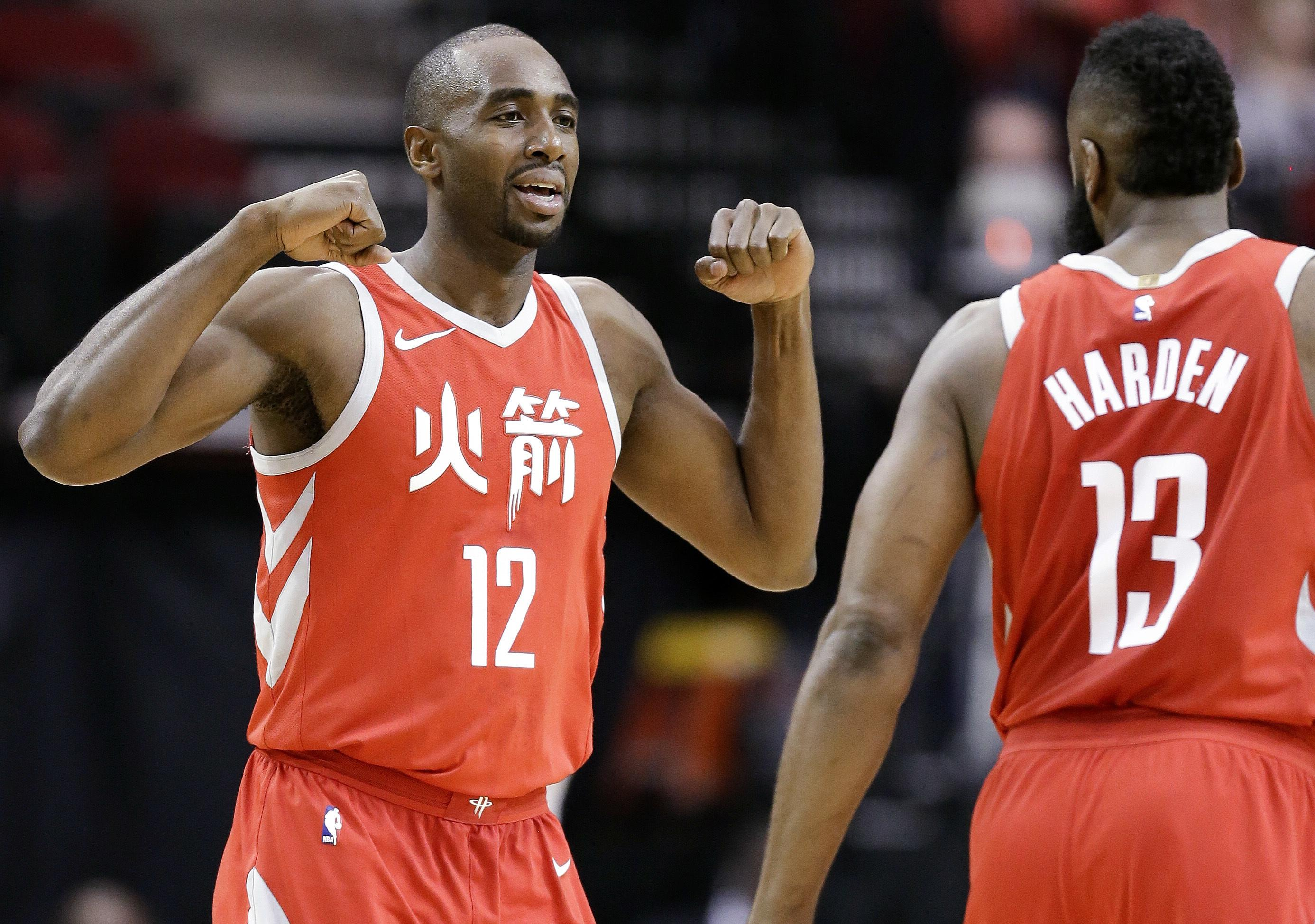 807170243a8 Houston Rockets forward Luc Mbah a Moute (12) celebrates after drawing a  foul