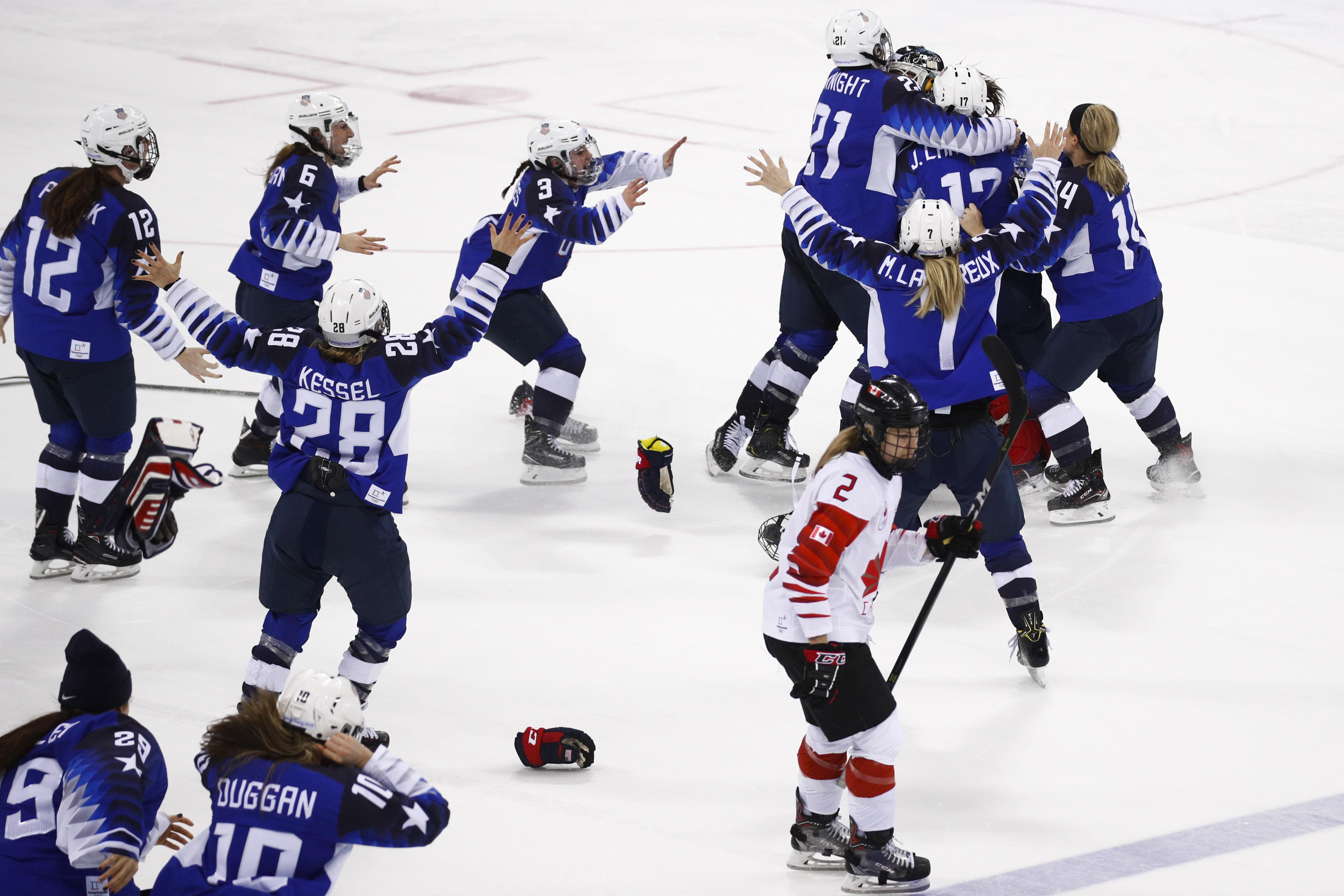 Grip on sports if you can pull yourself away from the olympic drama canadas meghan agosta 2 skates away as the united states players celebrate after winning solutioingenieria Images