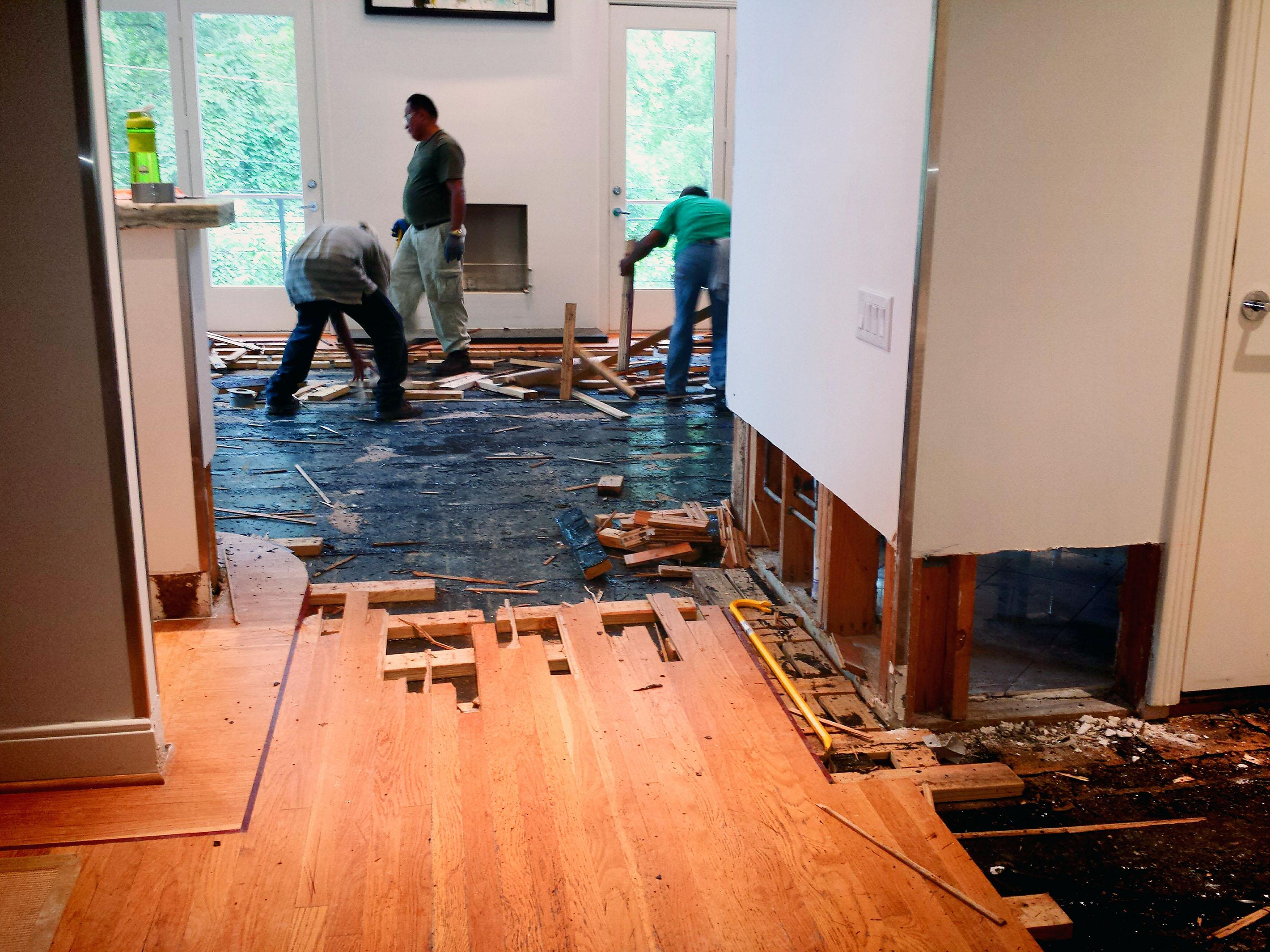Hardwood Floor Being Ripped Up As Part Of The Hurricane Cleanup In Houston Tim