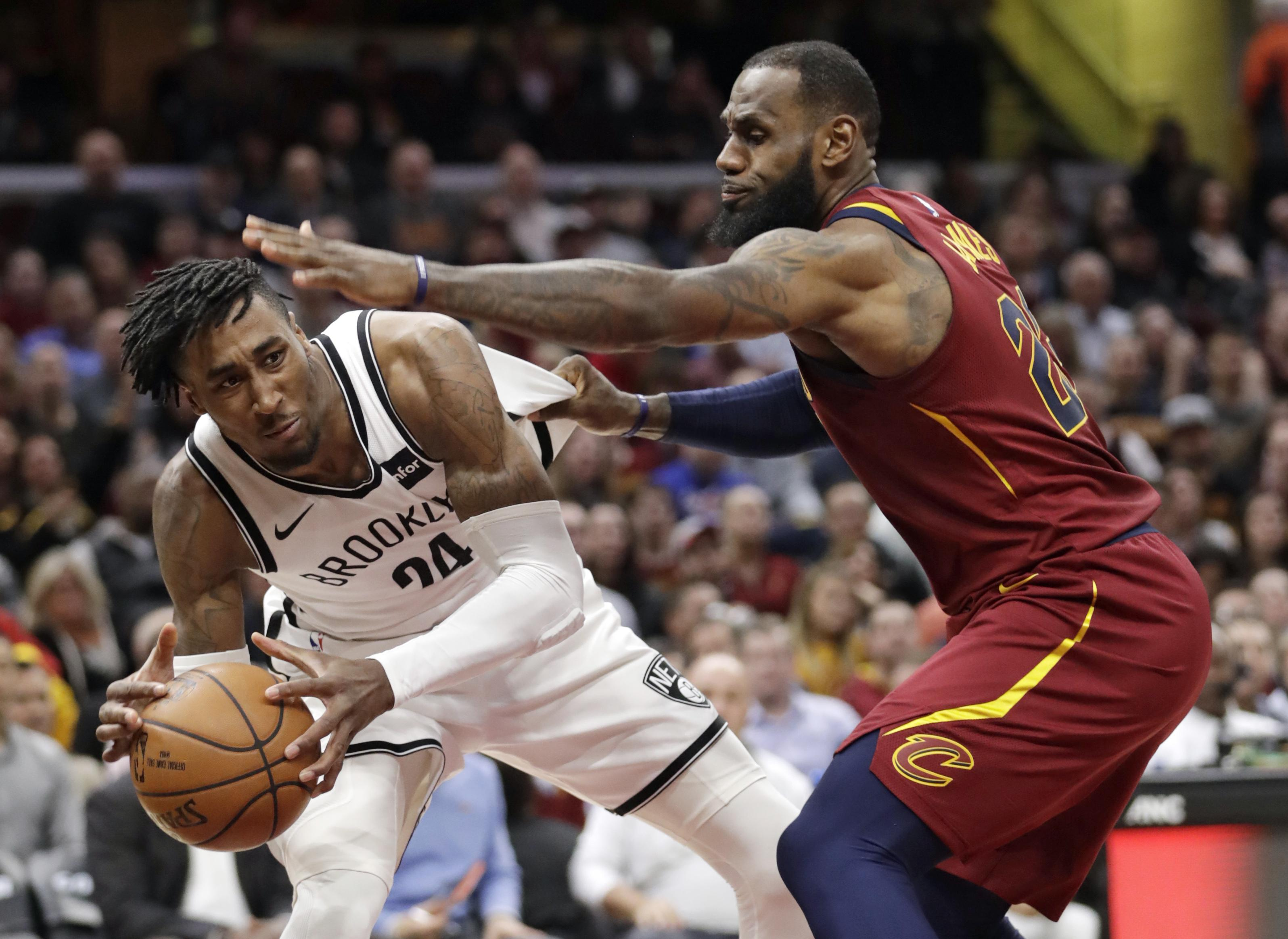 ee233dc93652 Brooklyn Nets' Rondae Hollis-Jefferson, left, looks to pass the ball as
