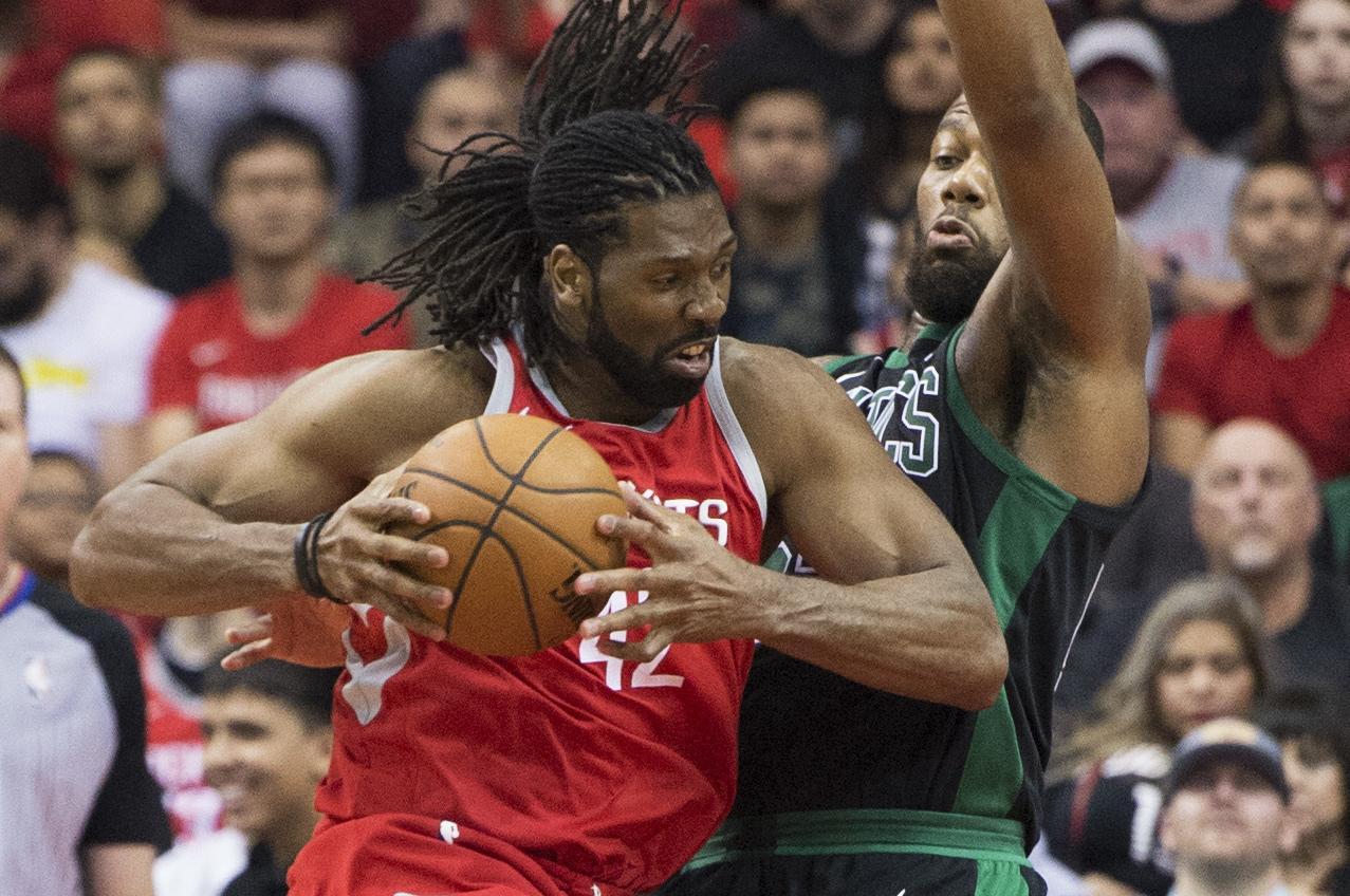 9ccf2981ef45 Houston Rockets center Nene (42) tries to get a shot against Boston Celtics  center