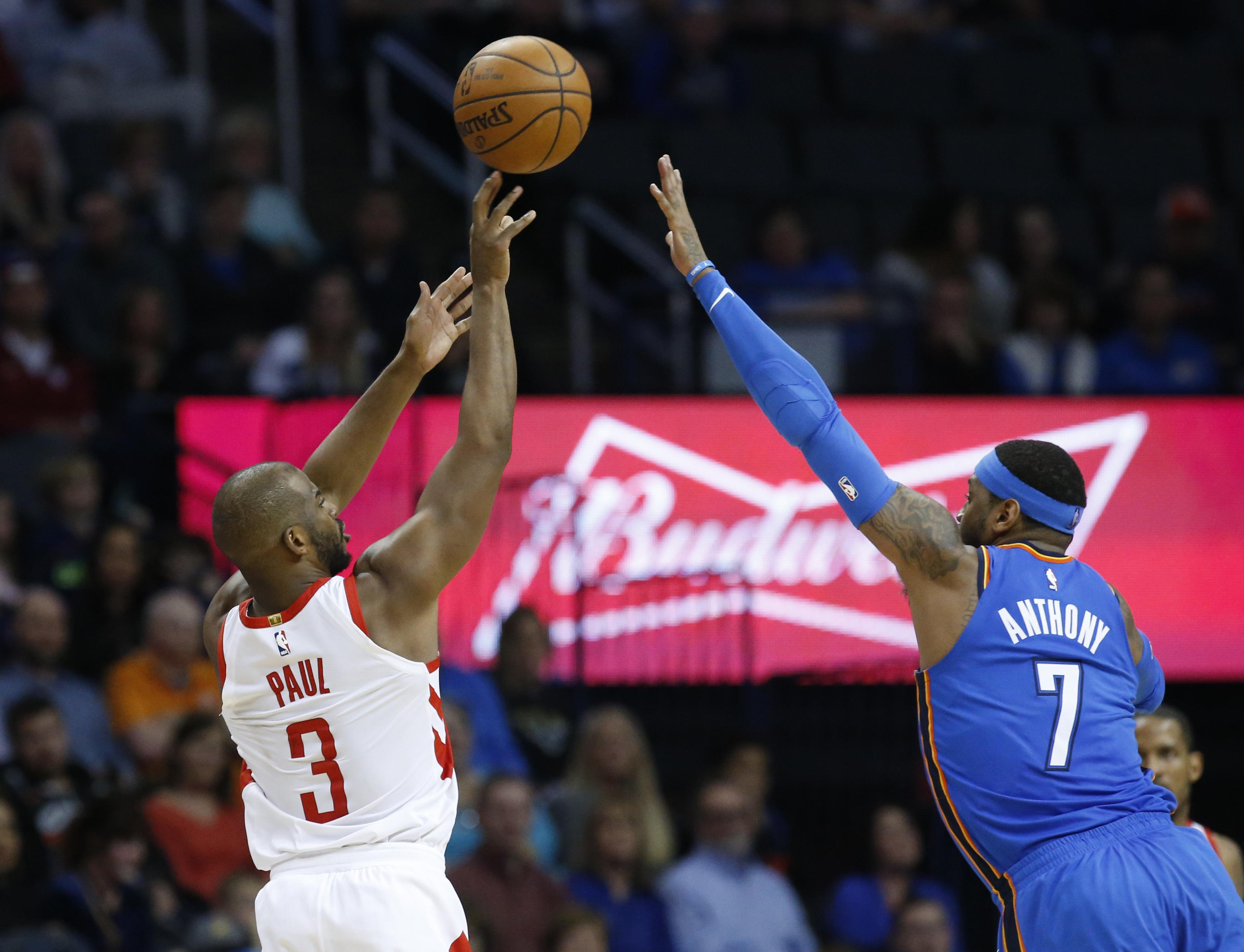 b8c23d65674 Houston Rockets guard Chris Paul (3) shoots over Oklahoma City Thunder  forward Carmelo Anthony
