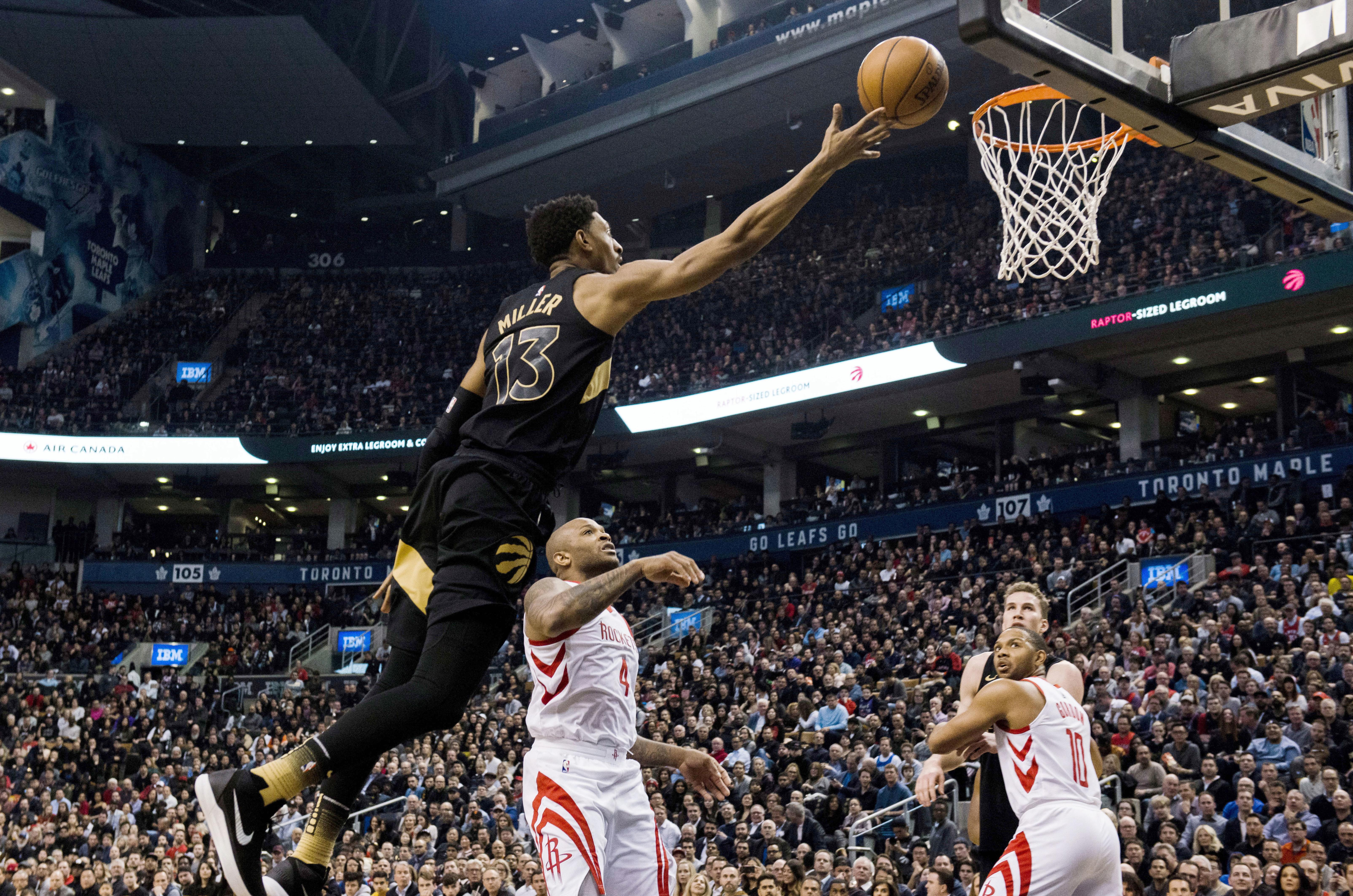 777bca1139ce Toronto Raptors forward Malcolm Miller goes for a layup against the Houston  Rockets in Toronto