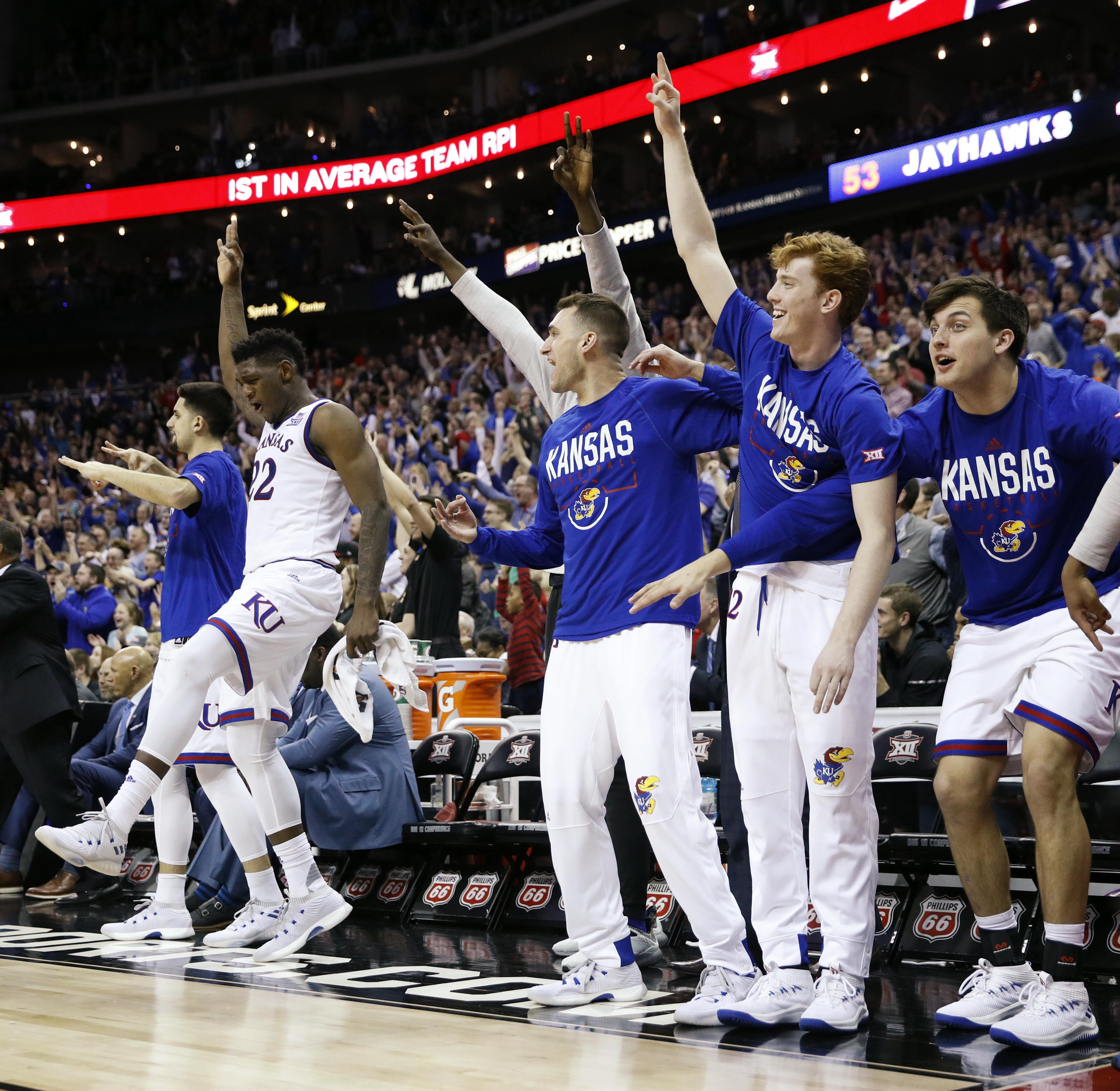 kansas players celebrate during the second half of the ncaa college basketball championship game against west