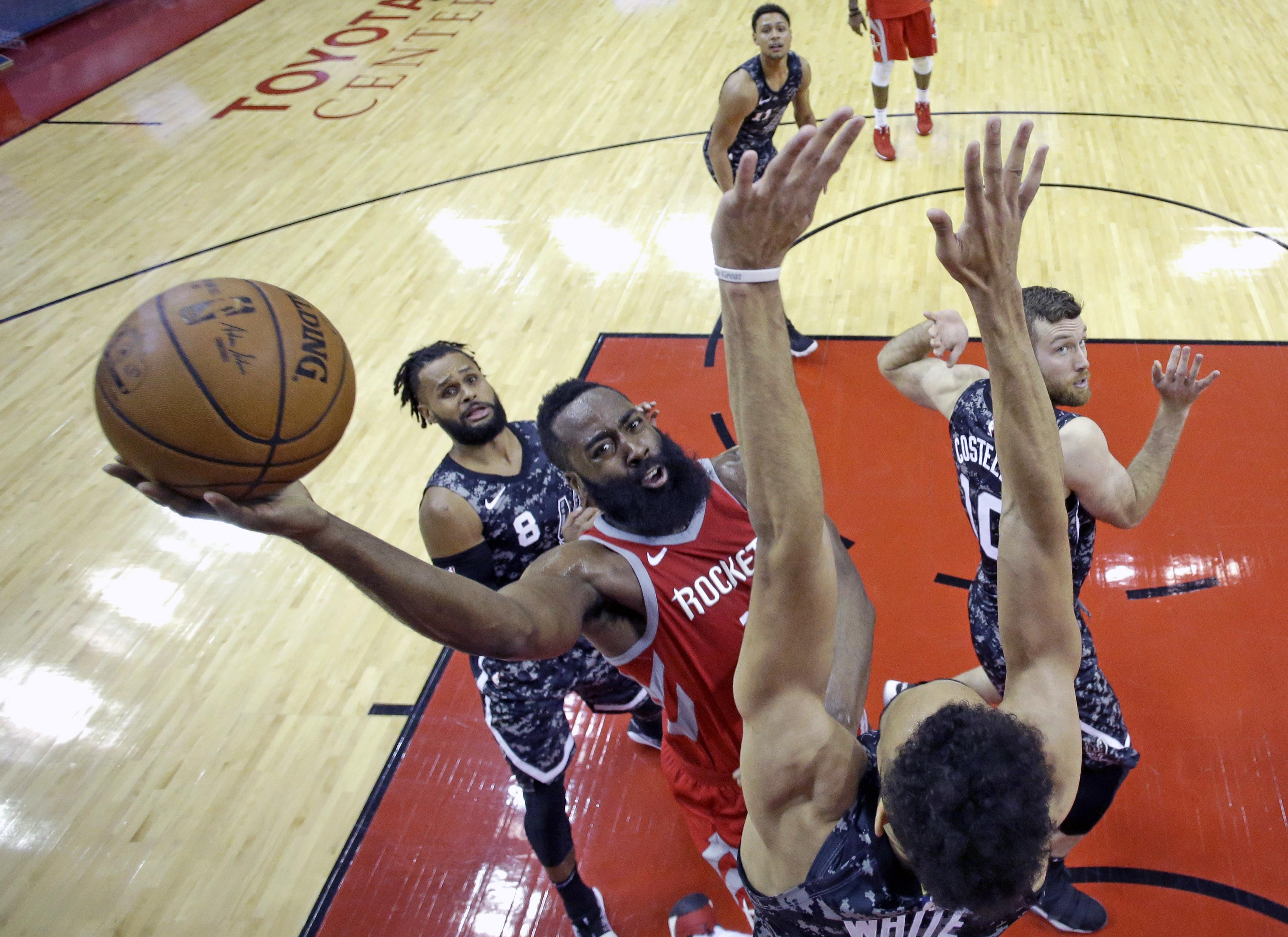 6d826fa7945 Rockets guard James Harden shoots over San Antonio s Derrick White during  the second half Monday night