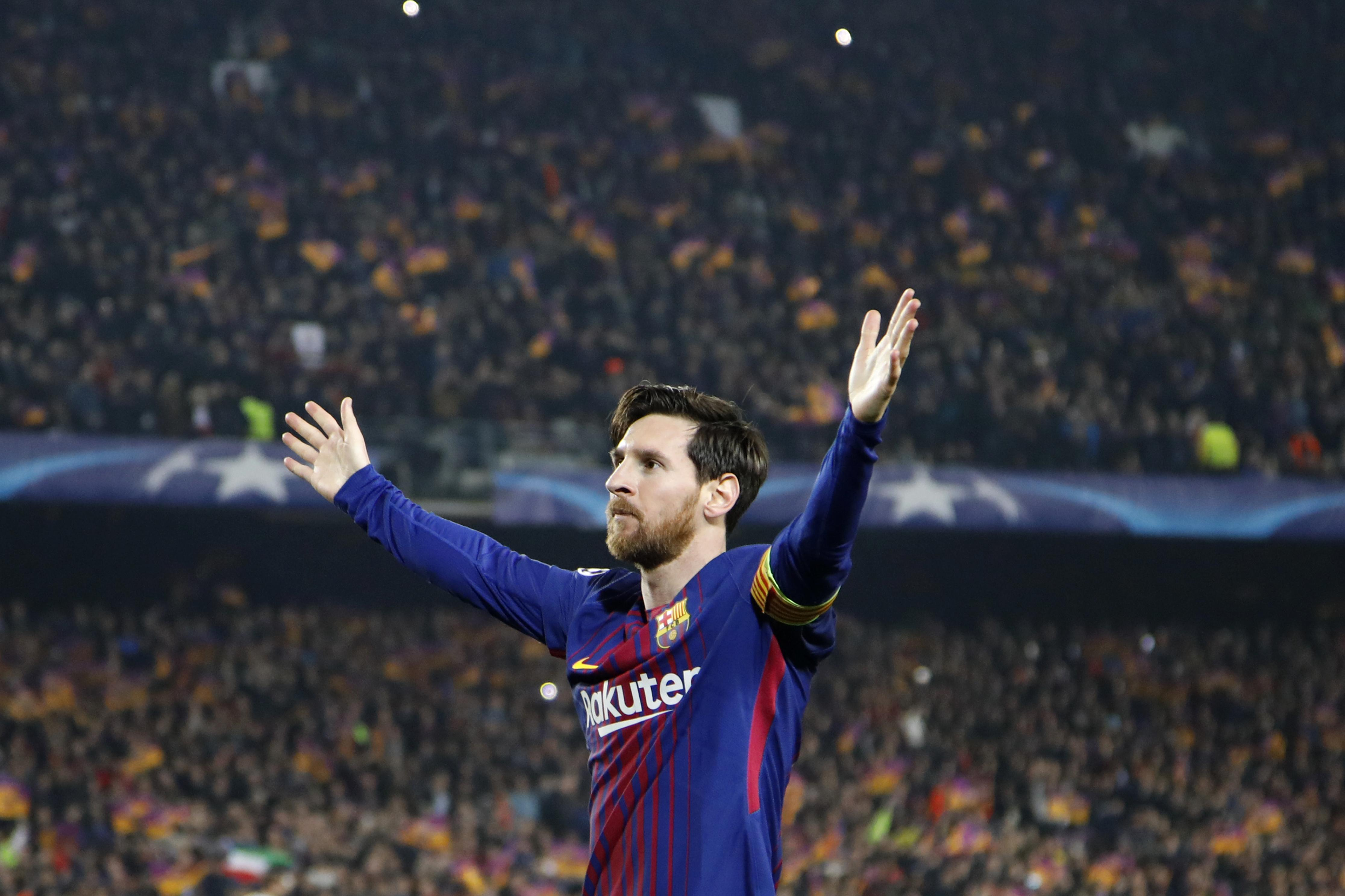 565788eac Barcelona s Lionel Messi celebrates after scoring his side s third goal  during the Champions League round of