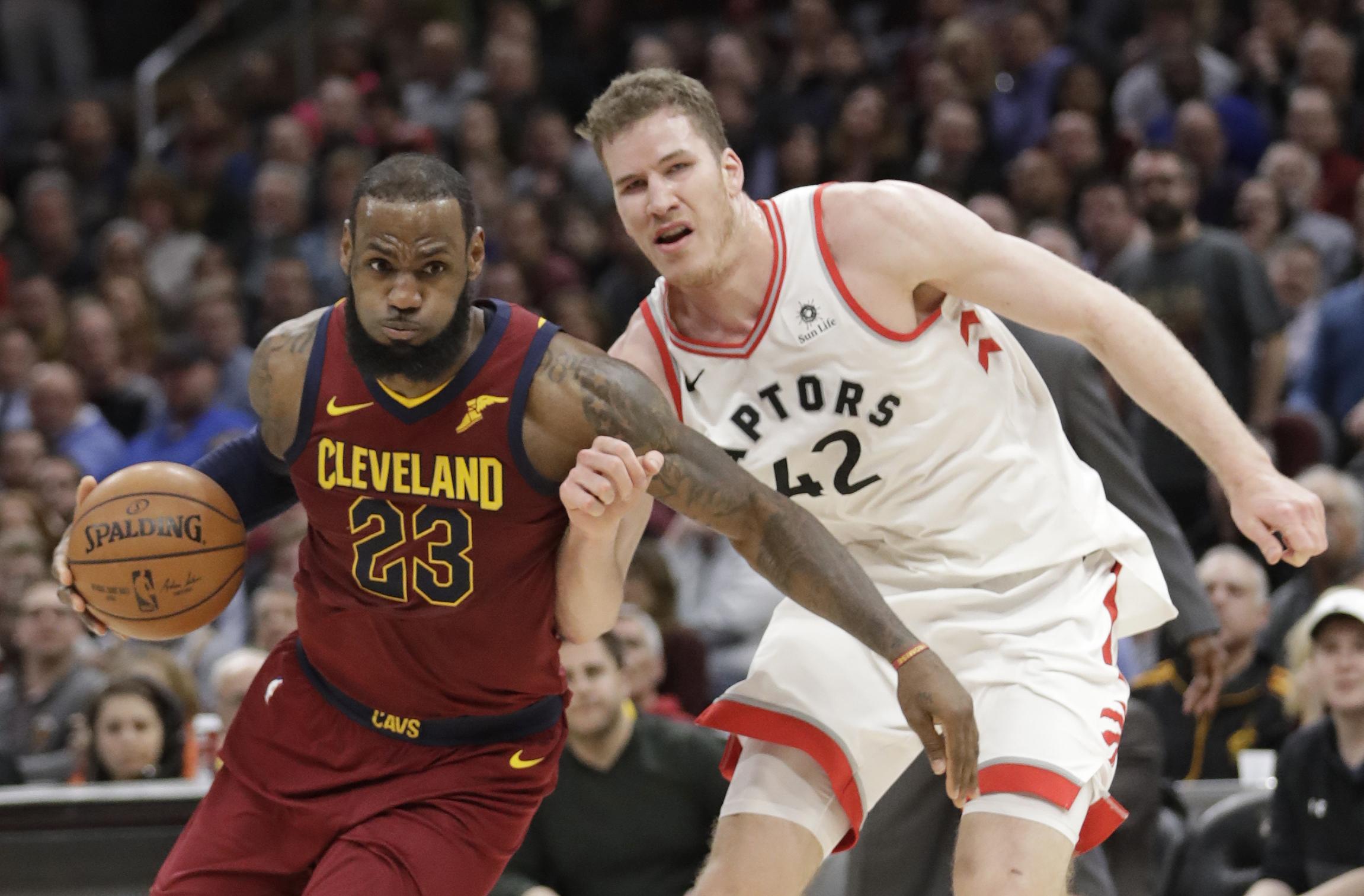 6cbc6f2cf Cleveland Cavaliers  LeBron James (23) drives past Toronto Raptors  Jakob  Poeltl (