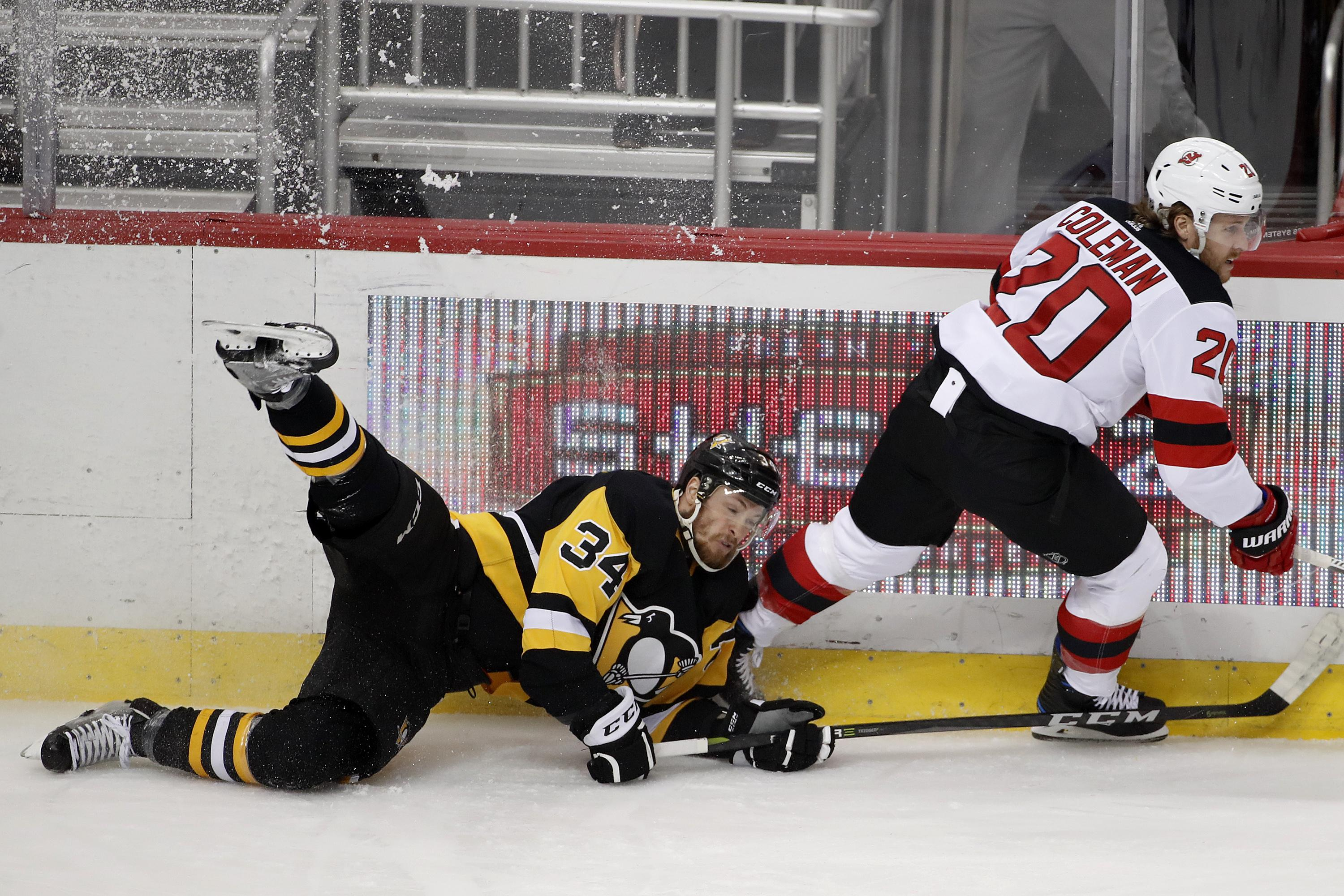 Pittsburgh s Tom Kuhnhackl collides with New Jersey s Blake Coleman during  the first period Friday in Pittsburgh a76b9c35b