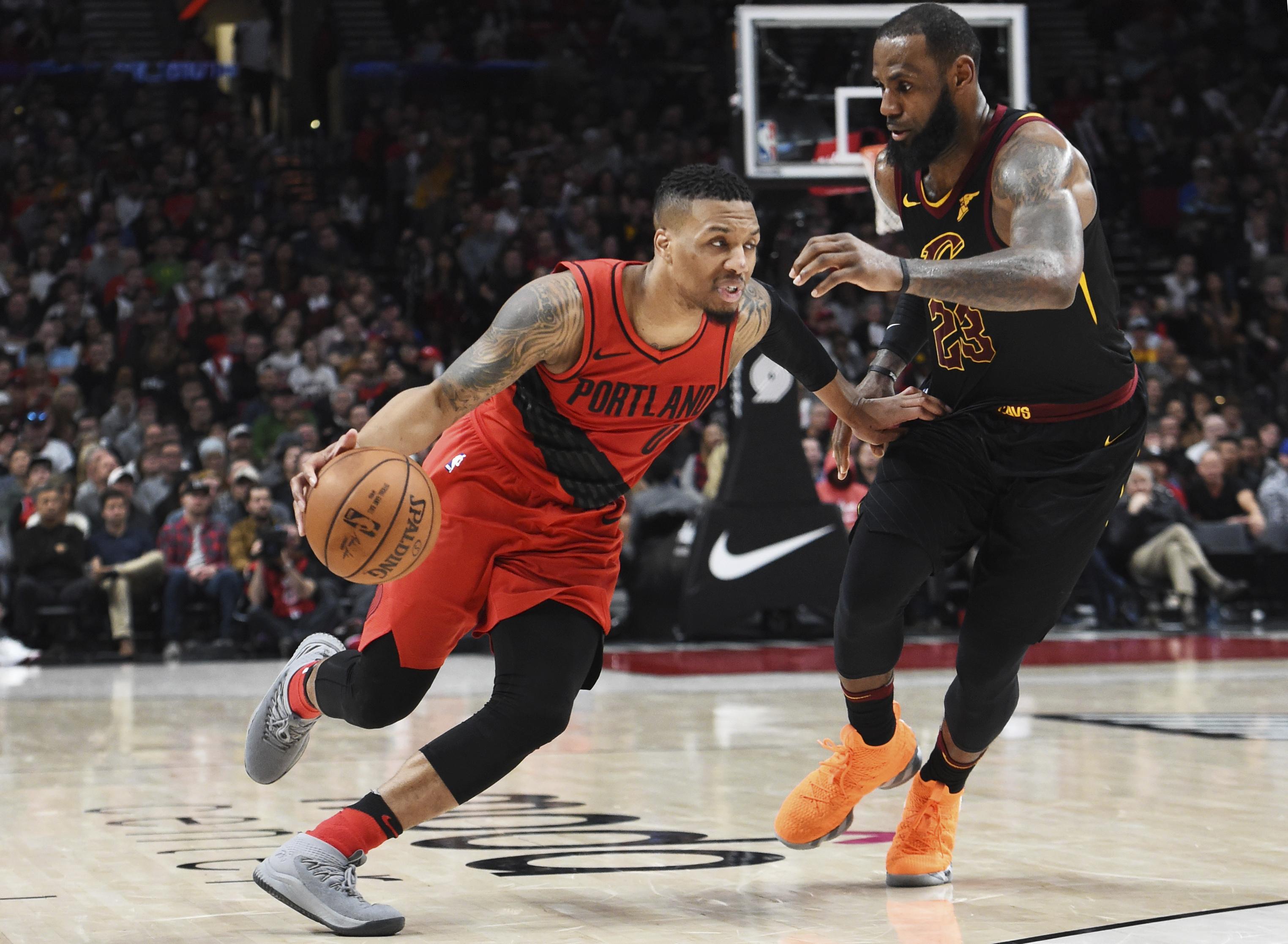 Portland Trail Blazers guard Damian Lillard drives to the basket past  Cleveland Cavaliers forward LeBron James 6c6514f95c