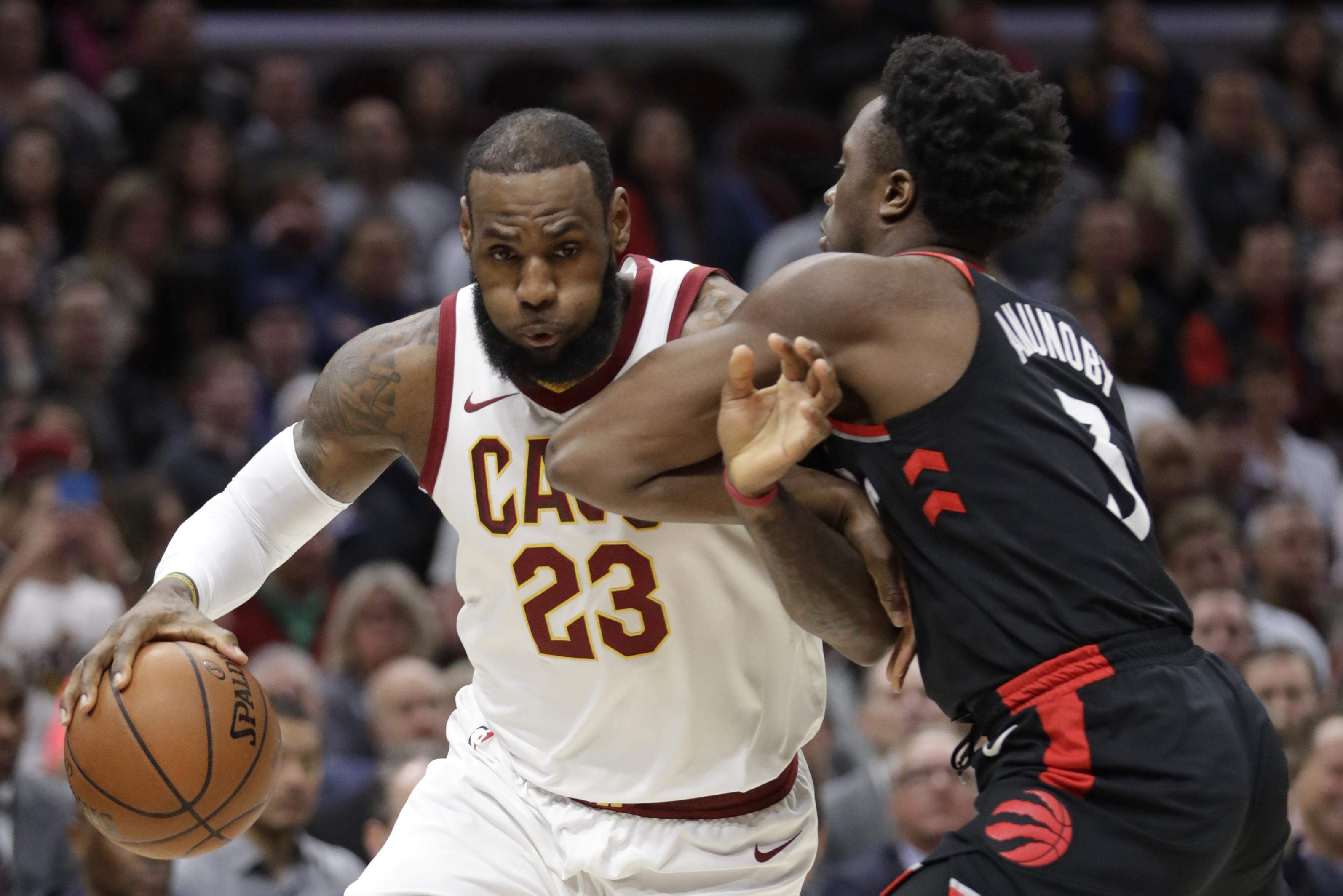 cheaper d820a 4868b Cleveland Cavaliers  LeBron James, left, drives past Toronto Raptors  OG  Anunoby during