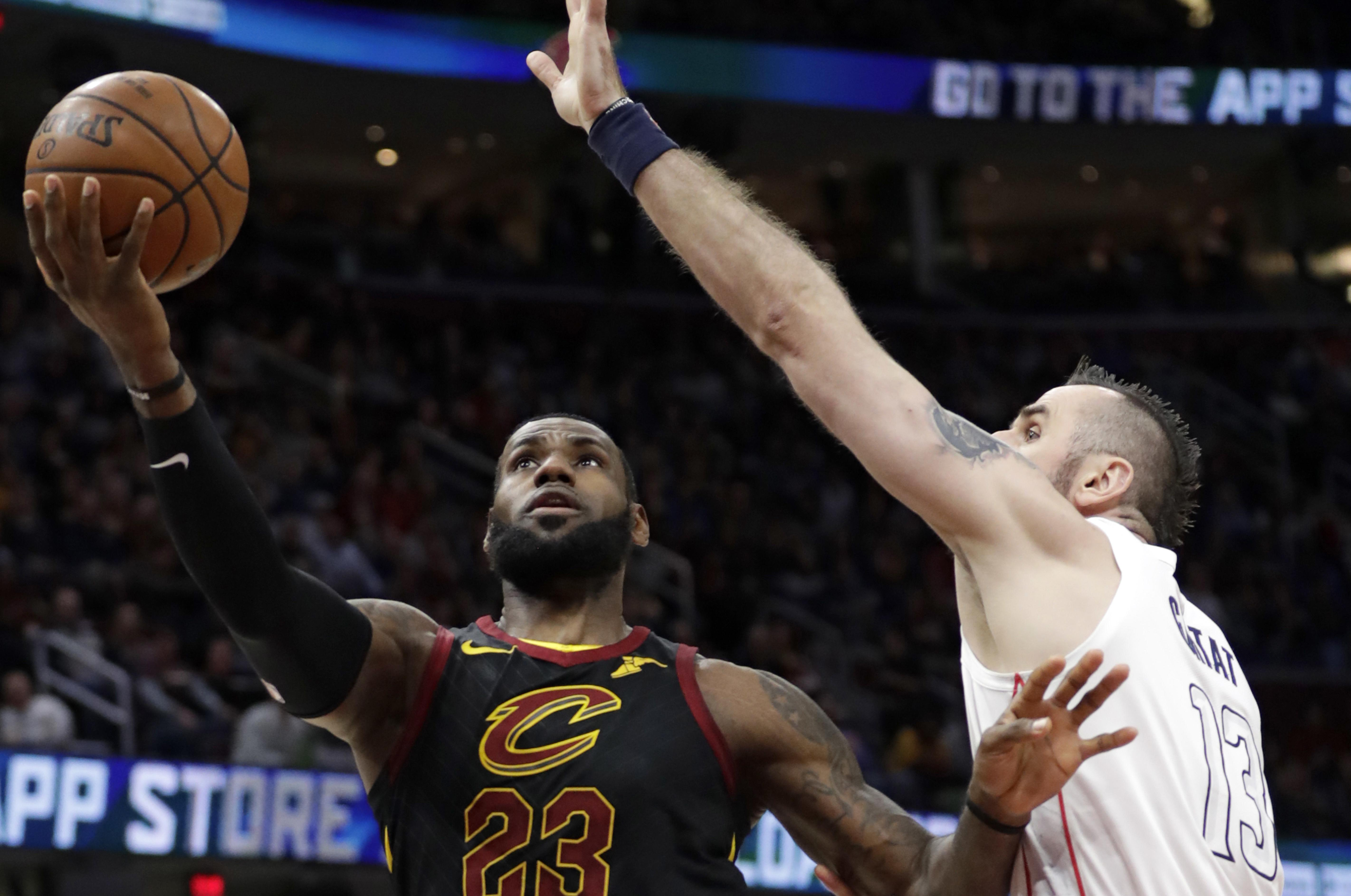 0d6c87b877d Cleveland Cavaliers  LeBron James drives to the basket against Washington  Wizards  Marcin Gortat in