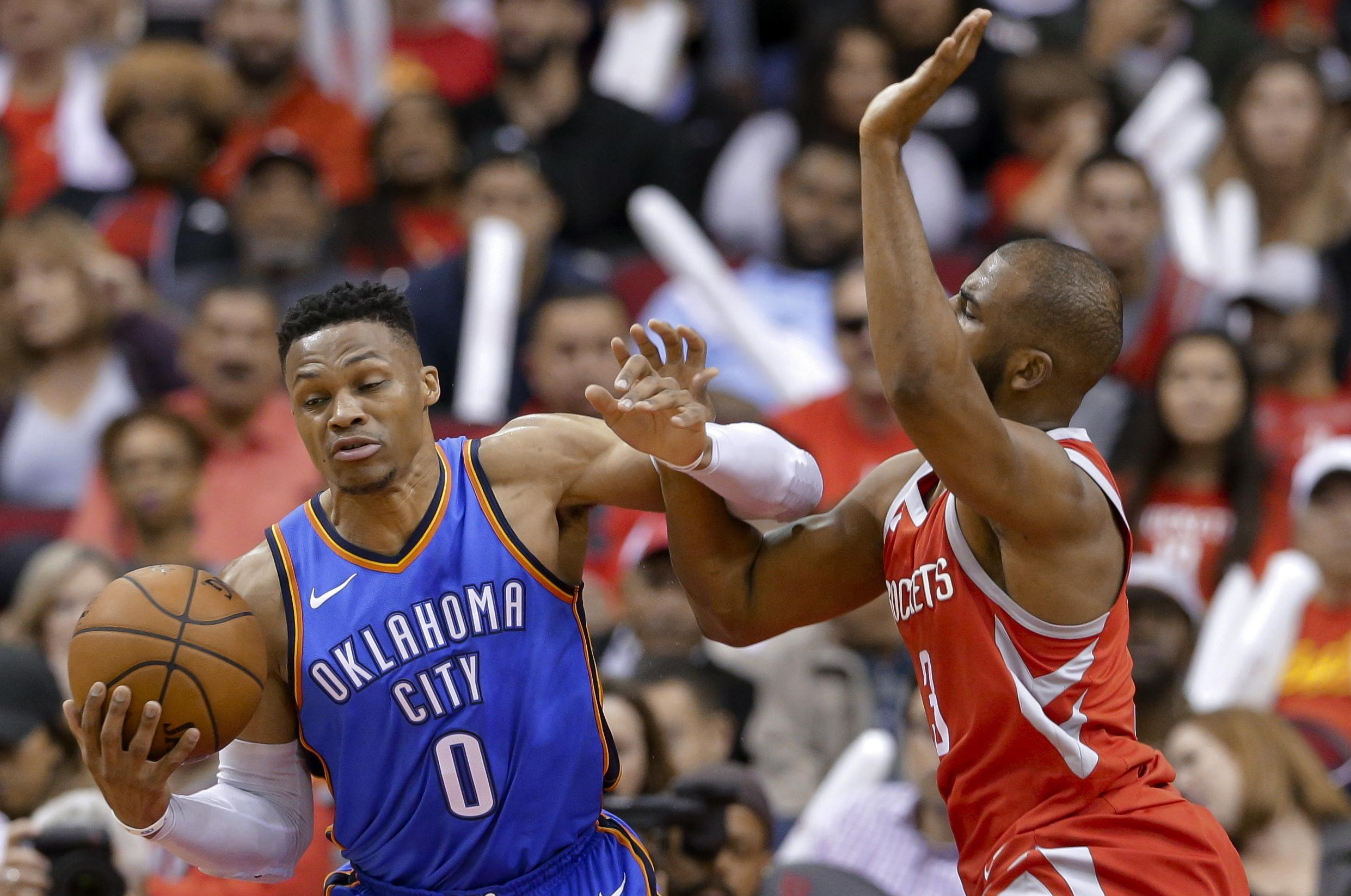 1befa64b572b Oklahoma City Thunder guard Russell Westbrook is fouled by Houston Rockets  guard Chris Paul during the