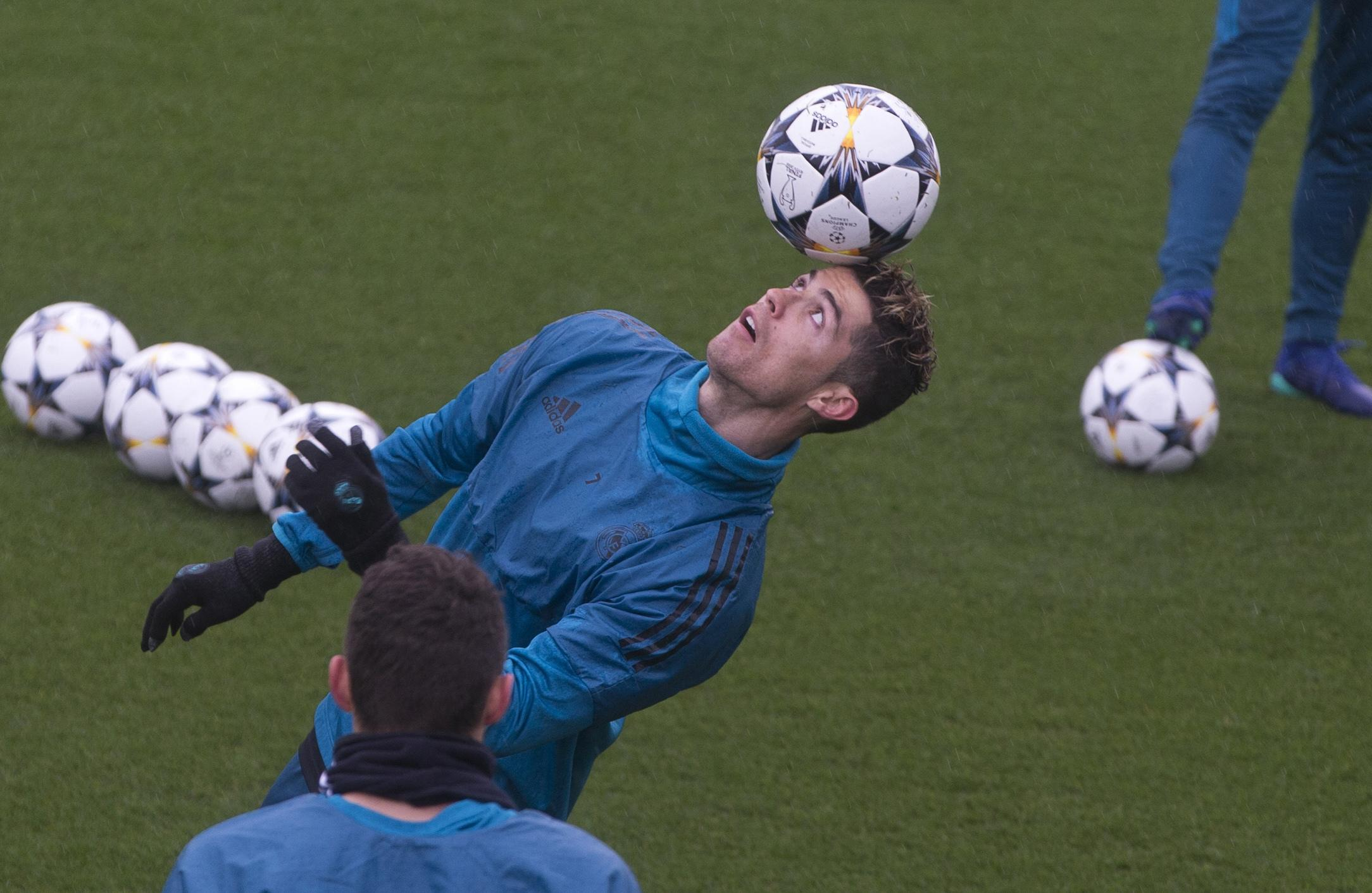 ef3673948c7 Real Madrid s Cristiano Ronaldo controls the ball during a training session  in Madrid