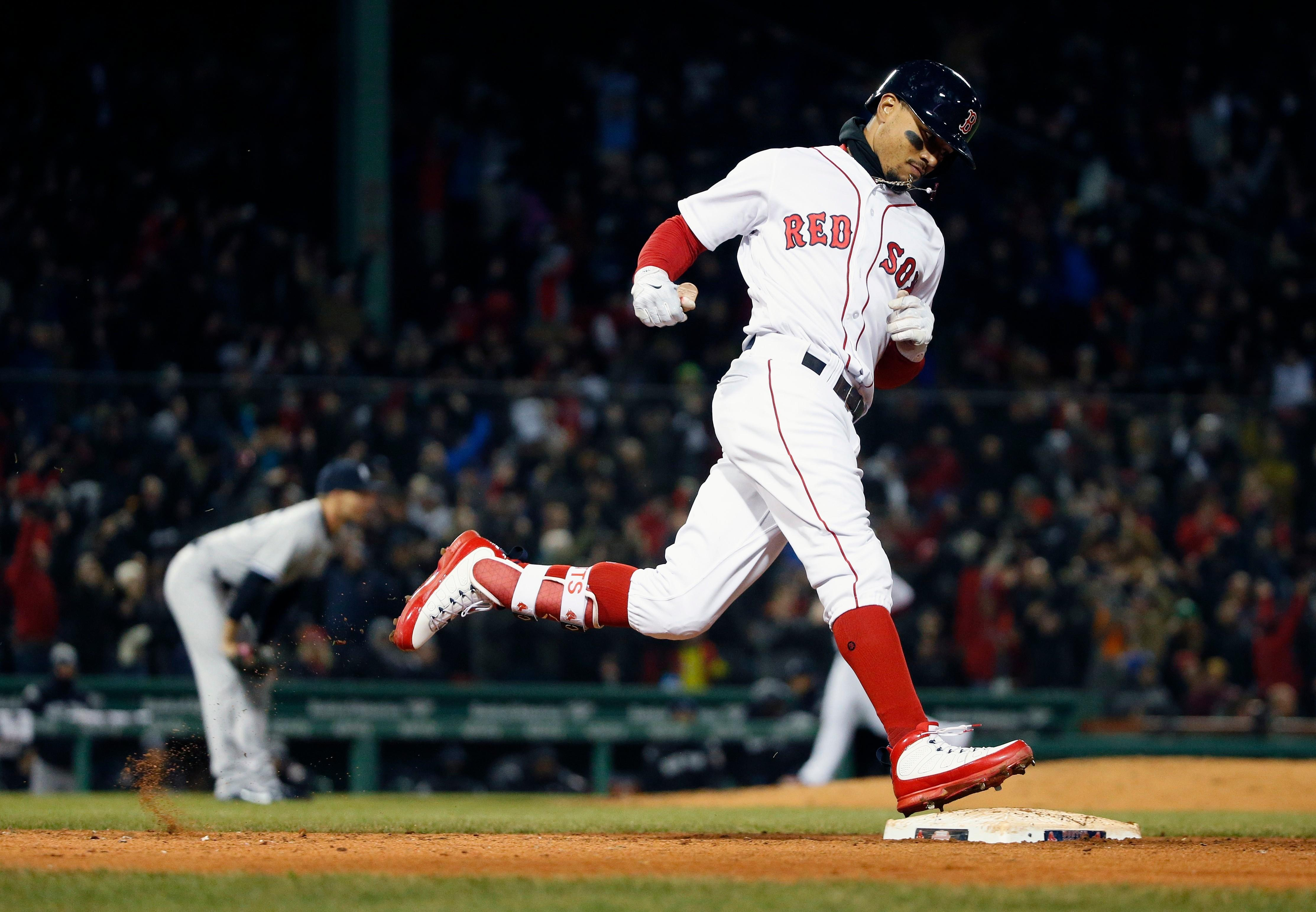 af7bfc6e8 Boston Red Sox s Mookie Betts rounds first base on his grand slam off New  York Yankees