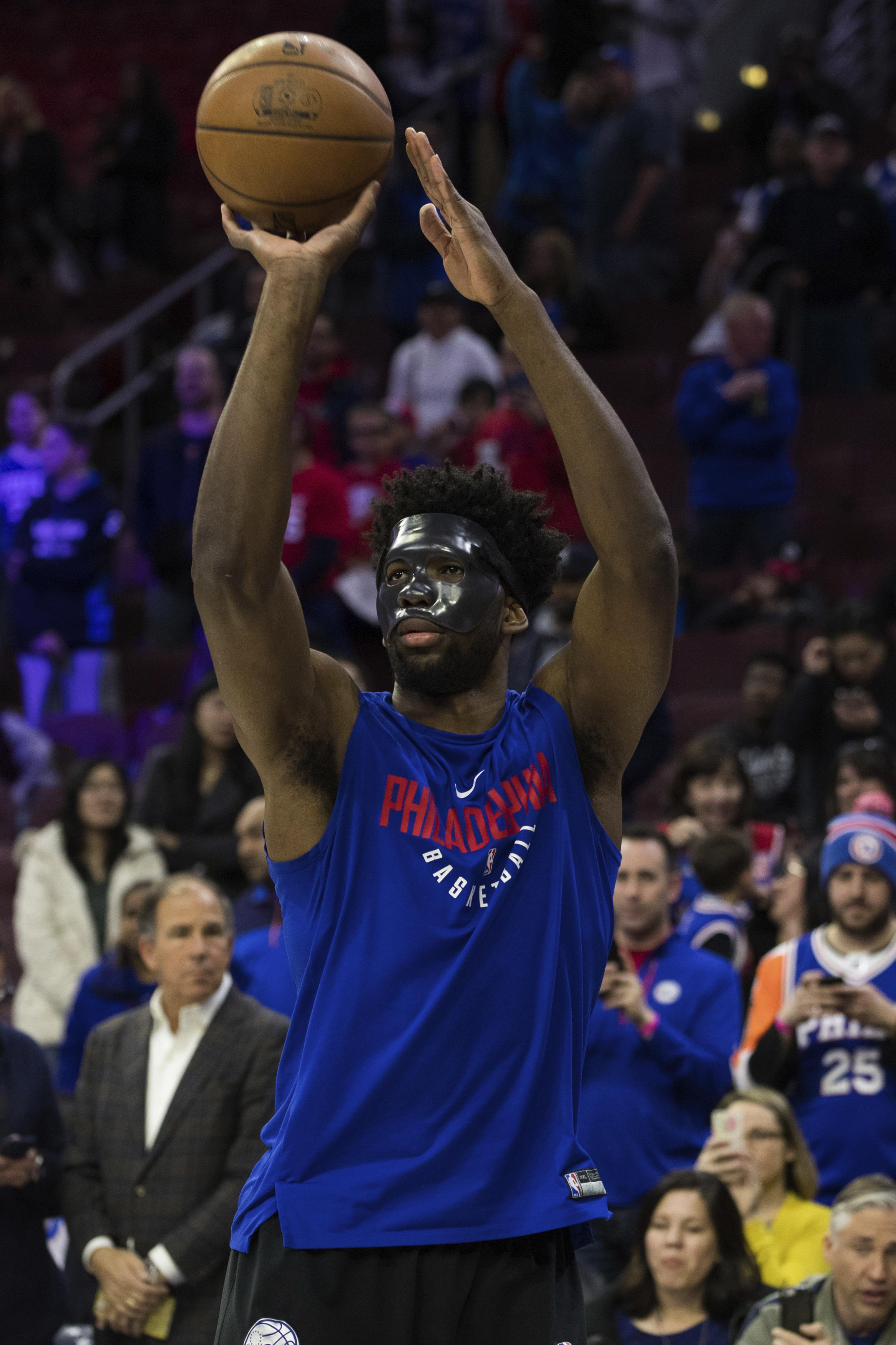 d7d5eeee8 Philadelphia 76ers  Joel Embiid wears mask while warming up for the team s NBA  basketball game
