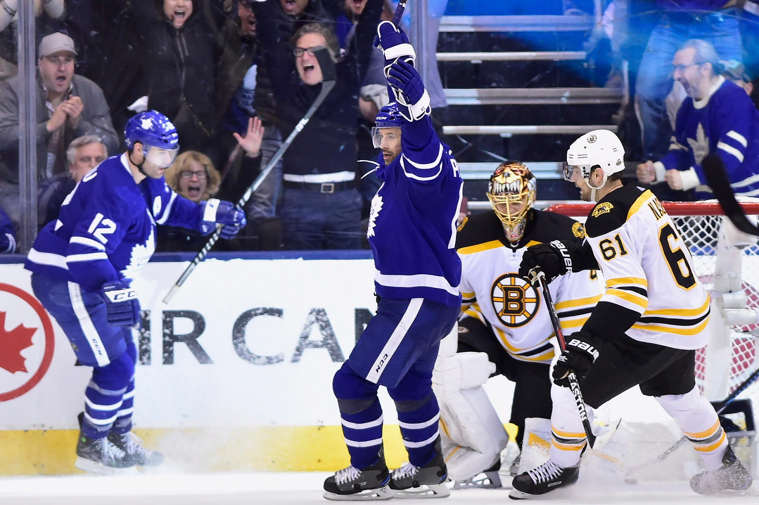 2780b1a1614 Toronto Maple Leafs centre Patrick Marleau, left, celebrates after scoring  on Boston Bruins goaltender