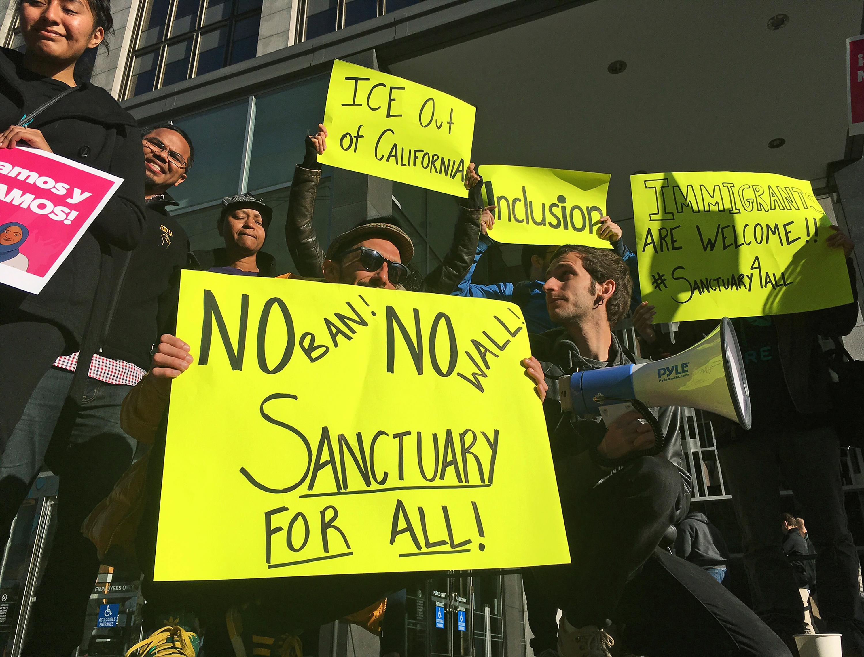 be29409cb95 Protesters rally outside a courthouse April 14, 2017, where a federal judge  heard arguments