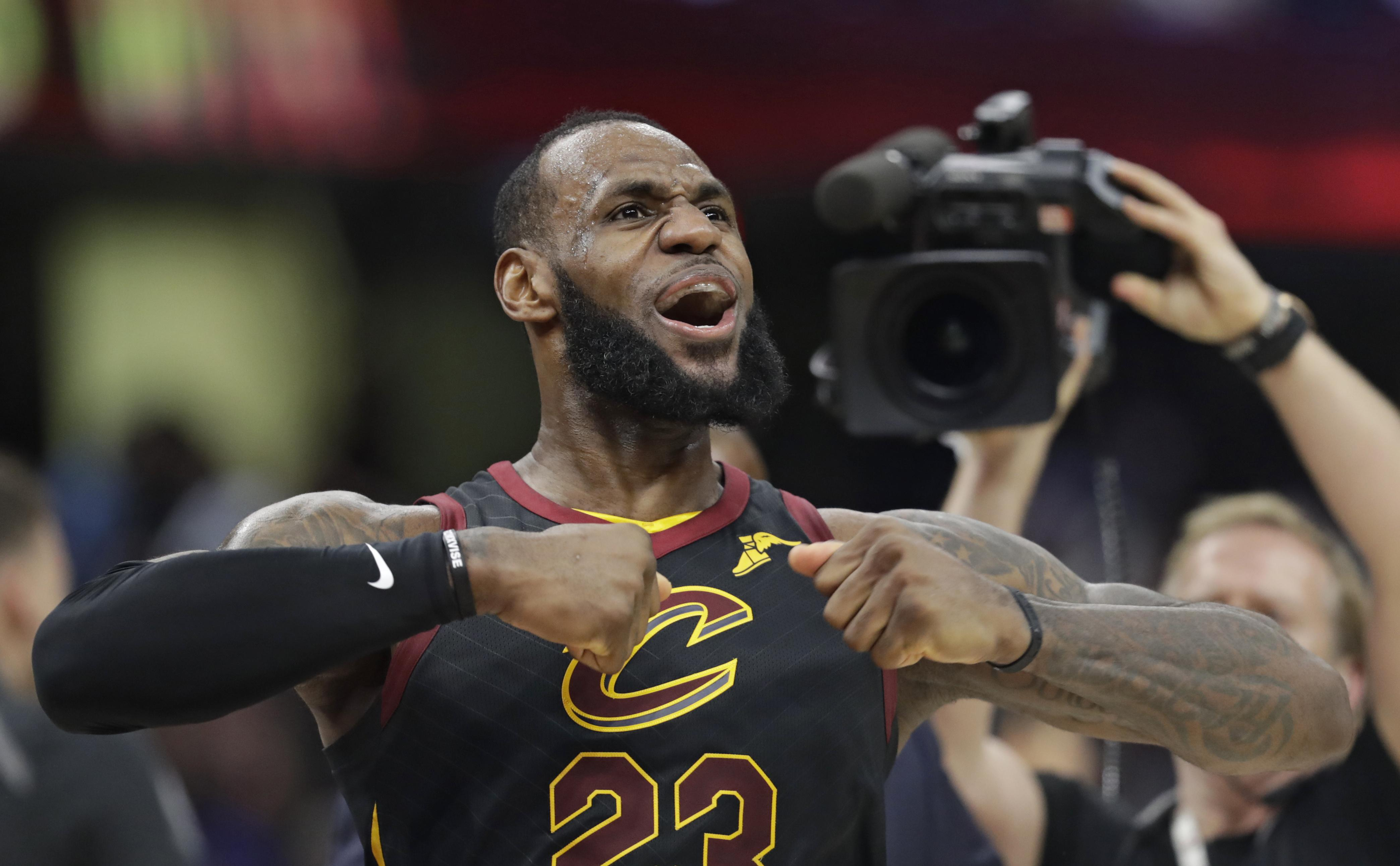Cleveland Cavaliers  LeBron James celebrates after scoring the game-winning  shot in the second 131afacf4