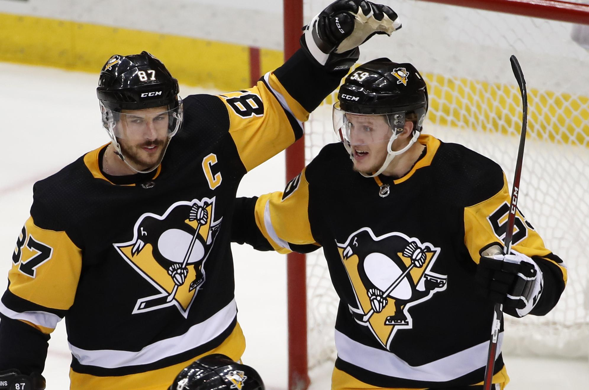 9e3989c6629 Pittsburgh Penguins  Jake Guentzel (59) celebrates his second goal of the  game