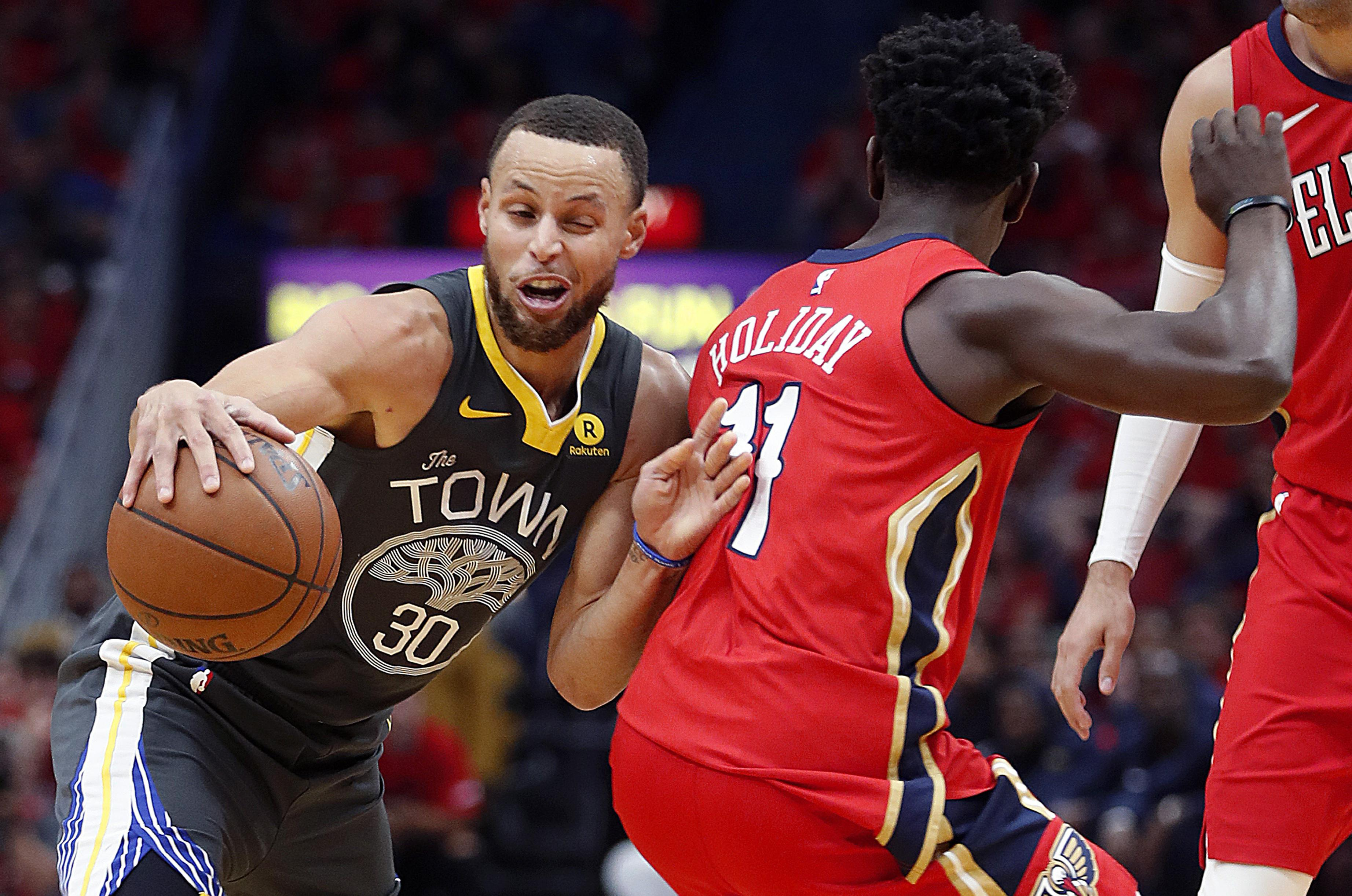 54c15ac802e4 Golden State Warriors guard Stephen Curry (30) tries to dribble around New  Orleans Pelicans