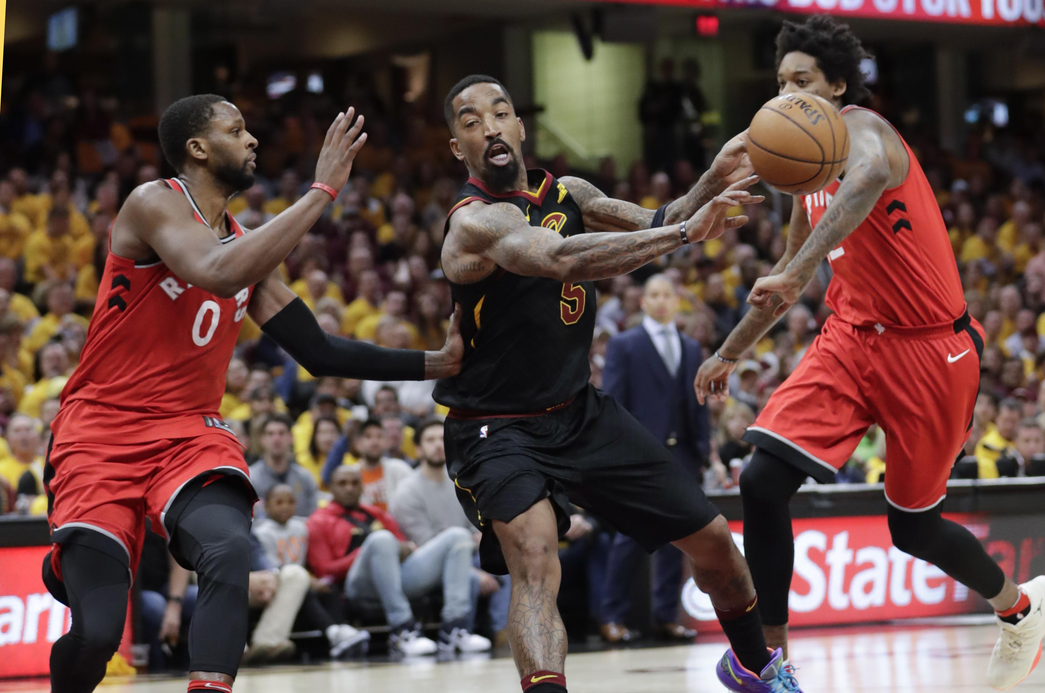 73449b48b0d Cleveland Cavaliers  JR Smith (5) passes against Toronto Raptors  CJ Miles (