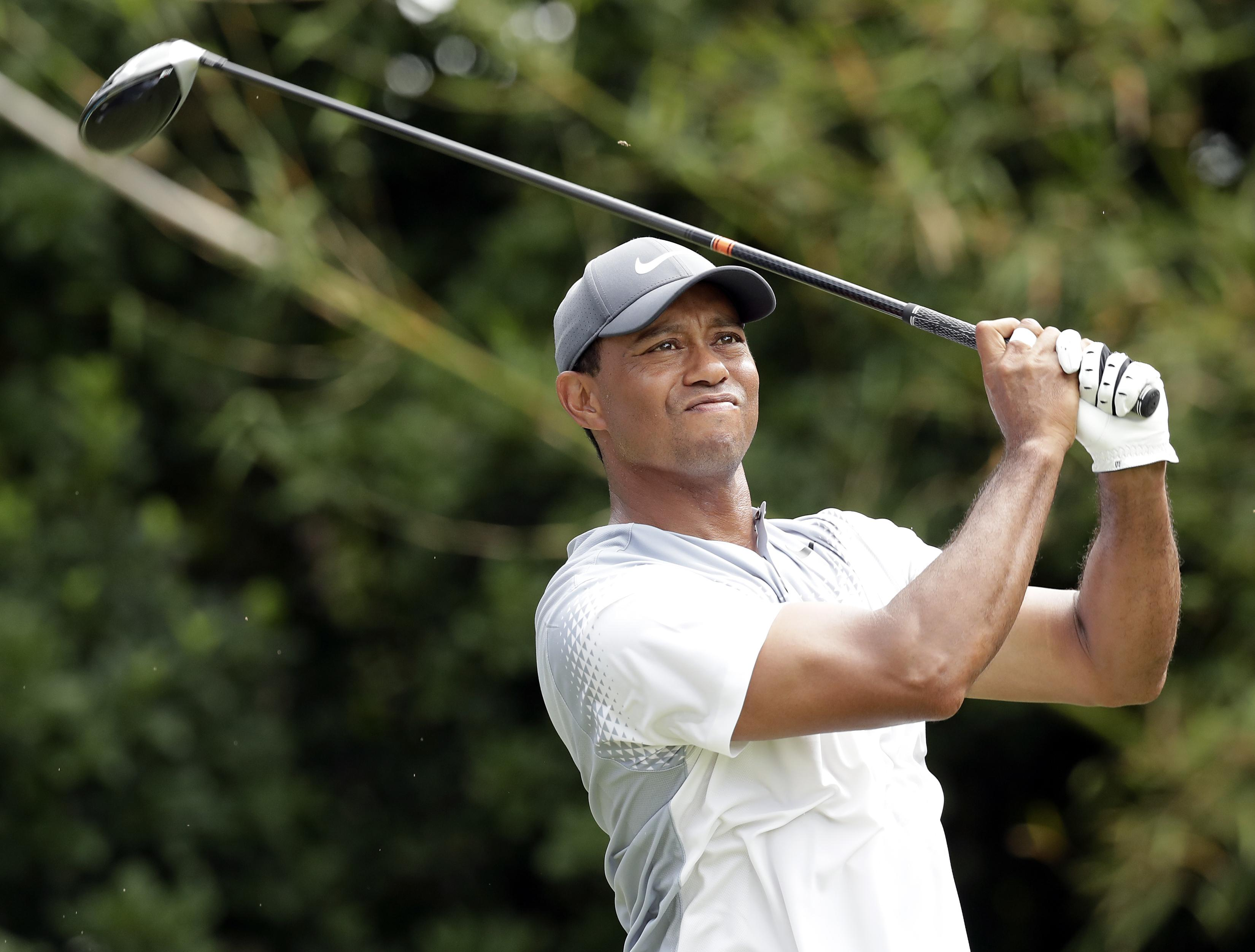 tiger woods shoots 65  his lowest score ever at players