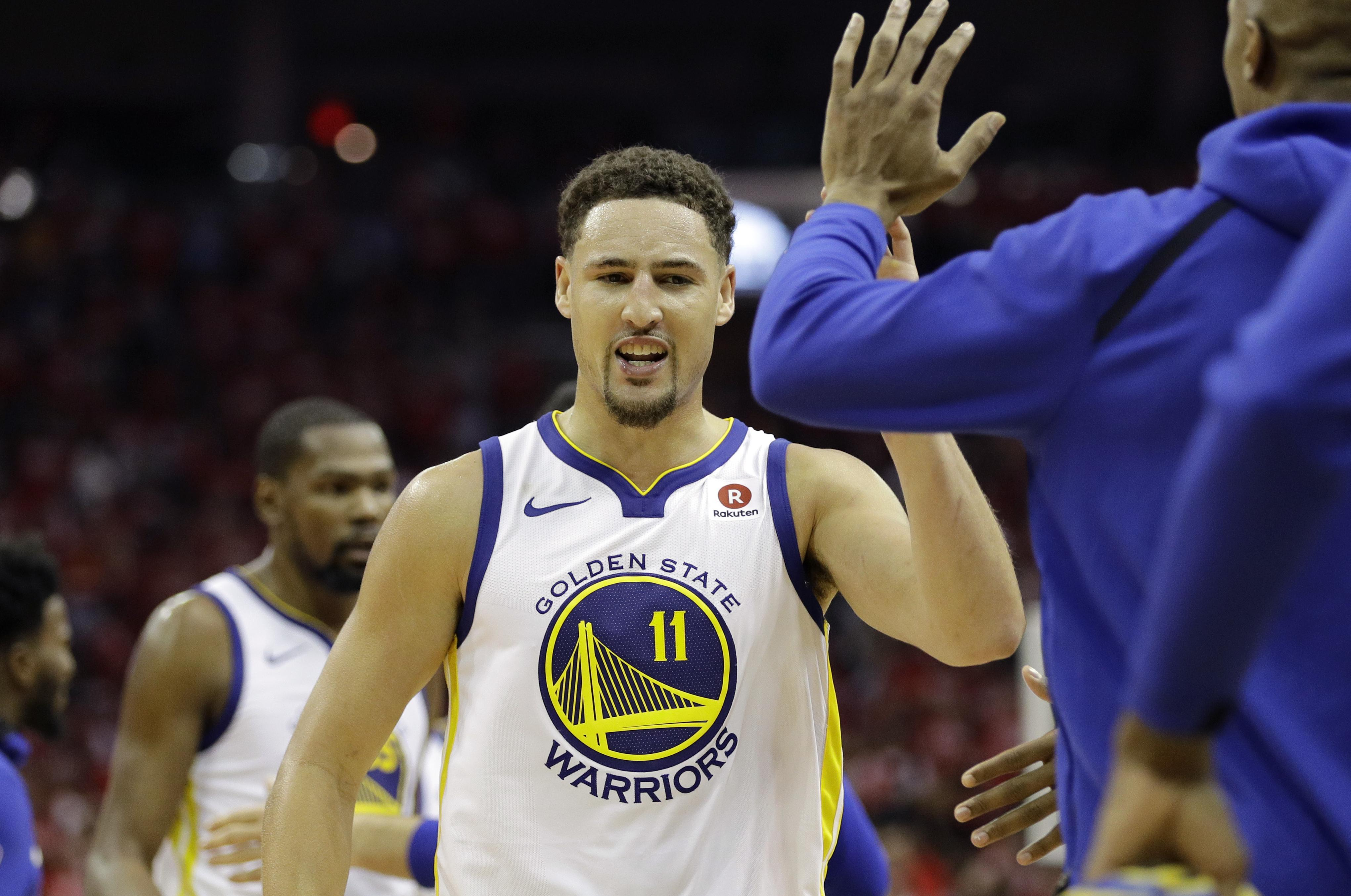 a628e792f86 Golden State Warriors guard Klay Thompson (11) celebrates with teammates  during the second half