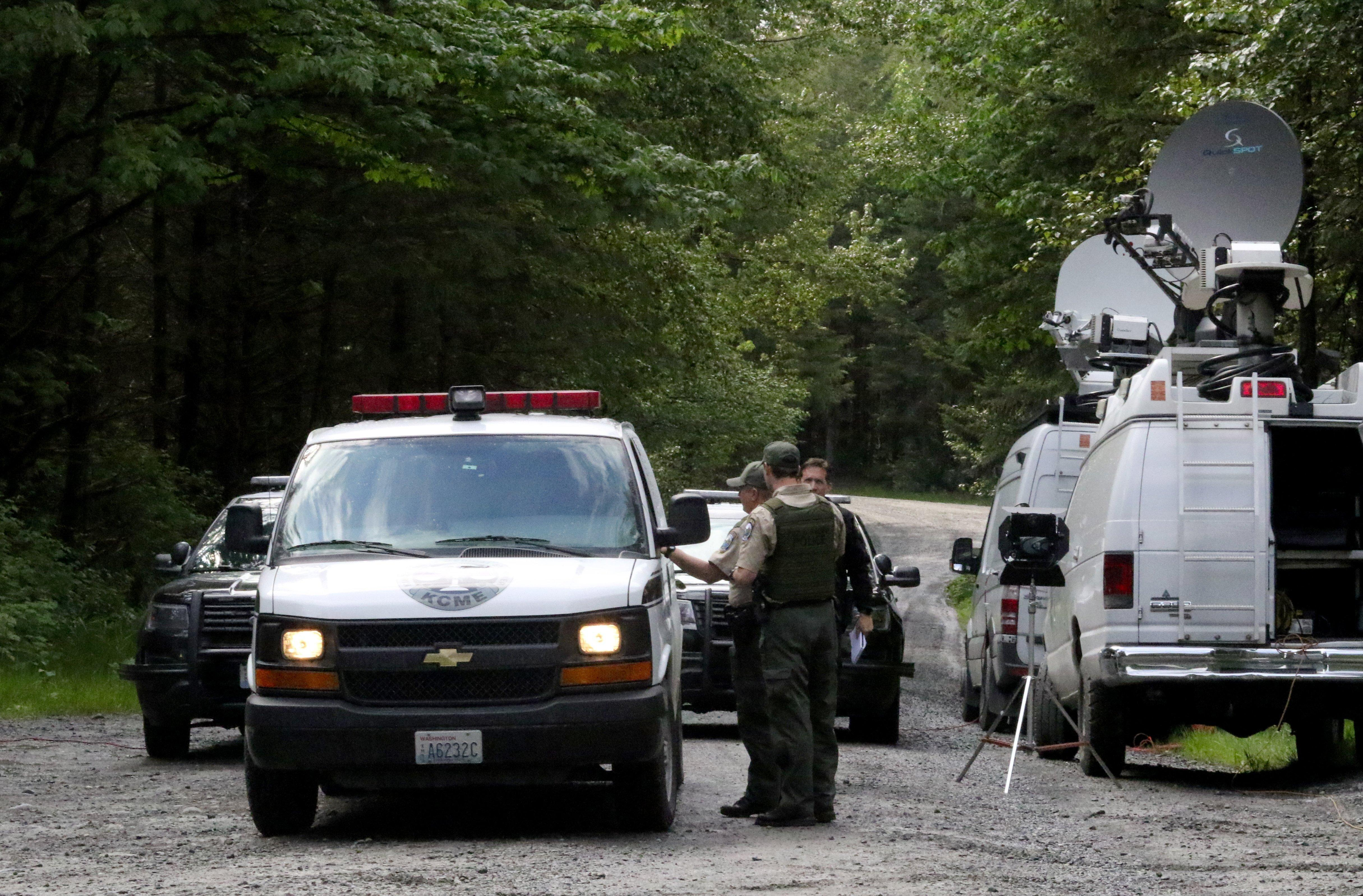 FILE - Washington State Fish and Wildlife Police confer with an individual  from the King County c0a7228d4