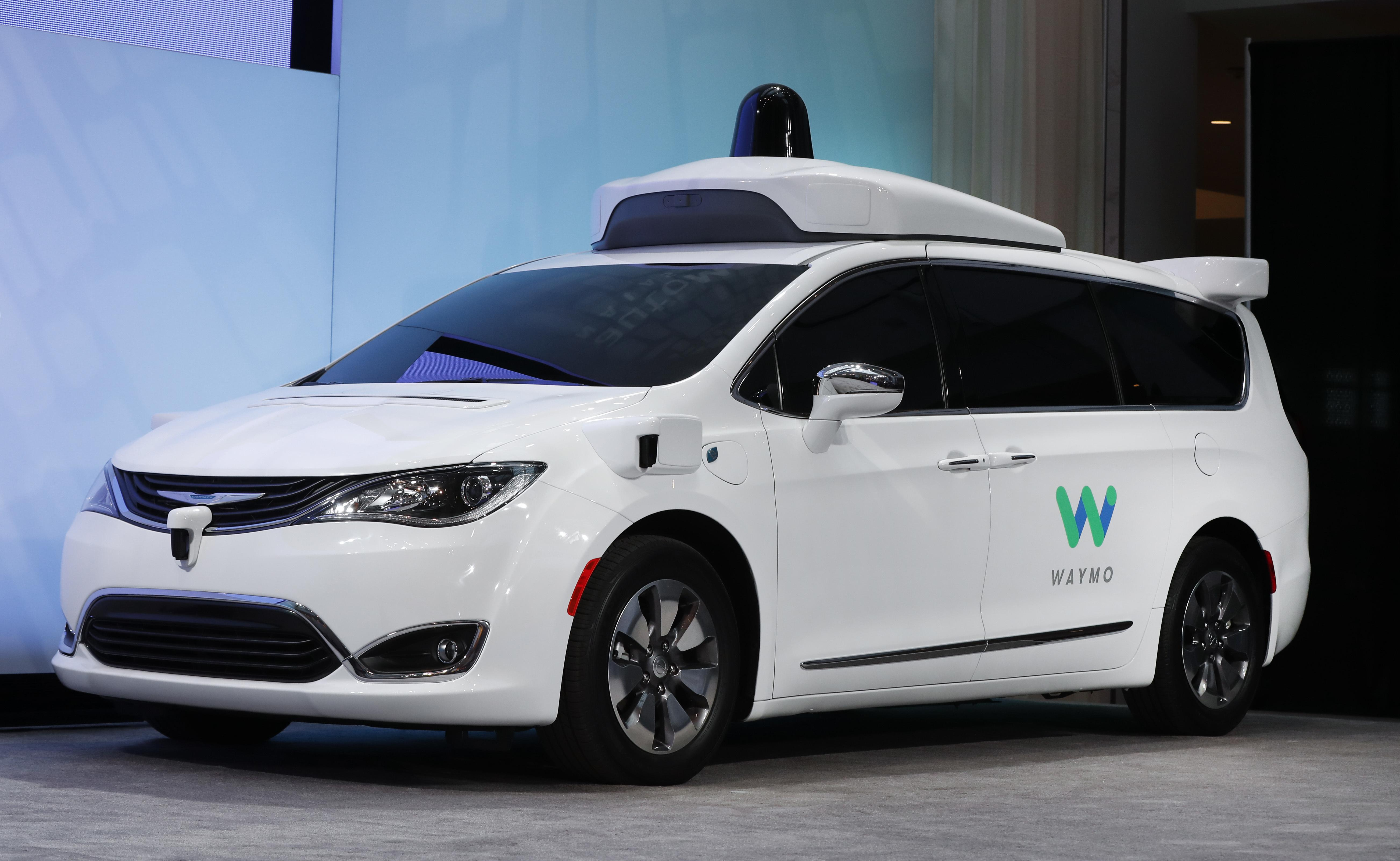 A Chrysler Pacifica Hybrid Outed With Waymo S Suite Of Sensors And Radar Is Displayed At The