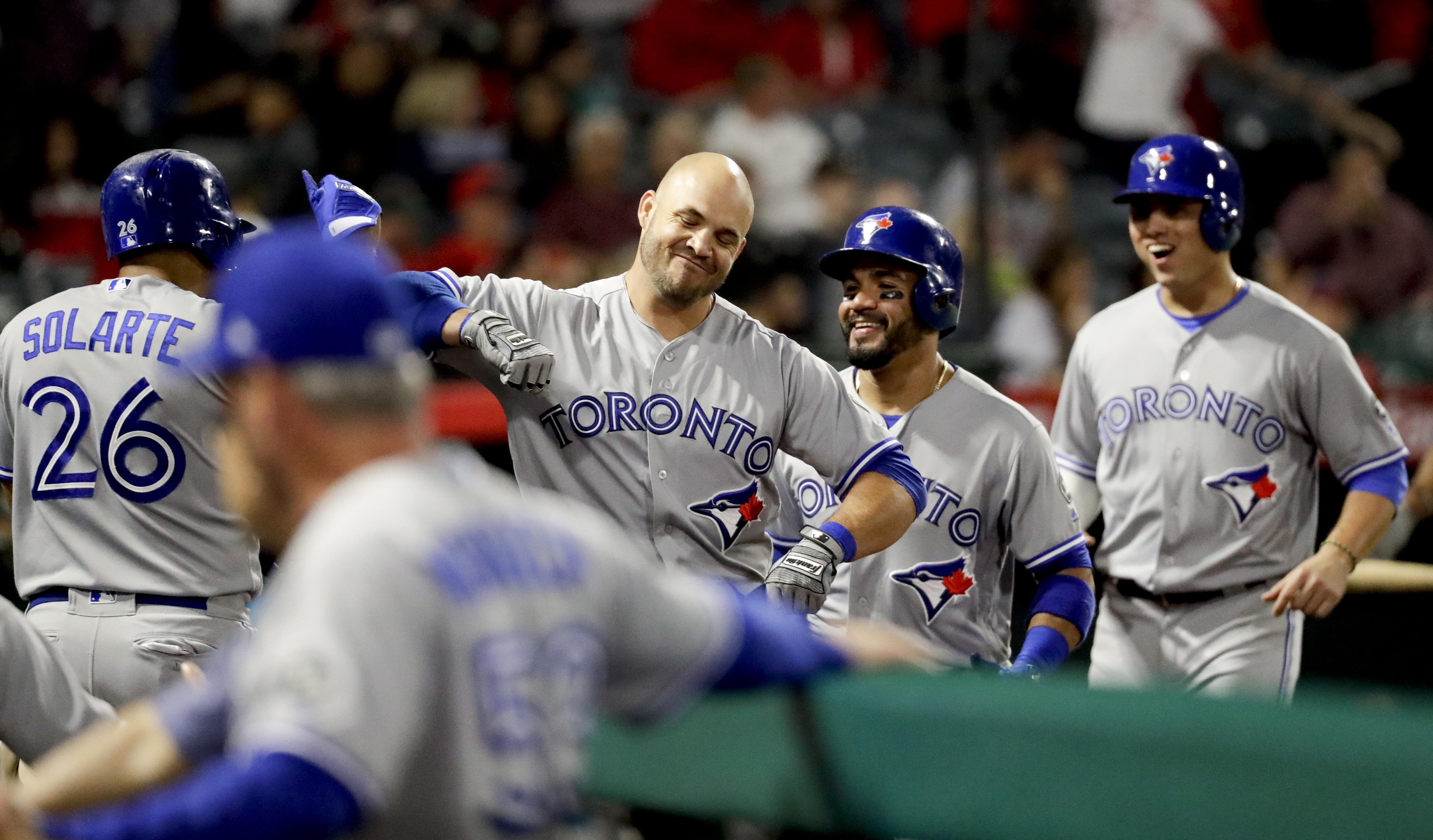 01bf0f72f Toronto Blue Jays' Steve Pearce, second from left, celebrates at the dugout  after