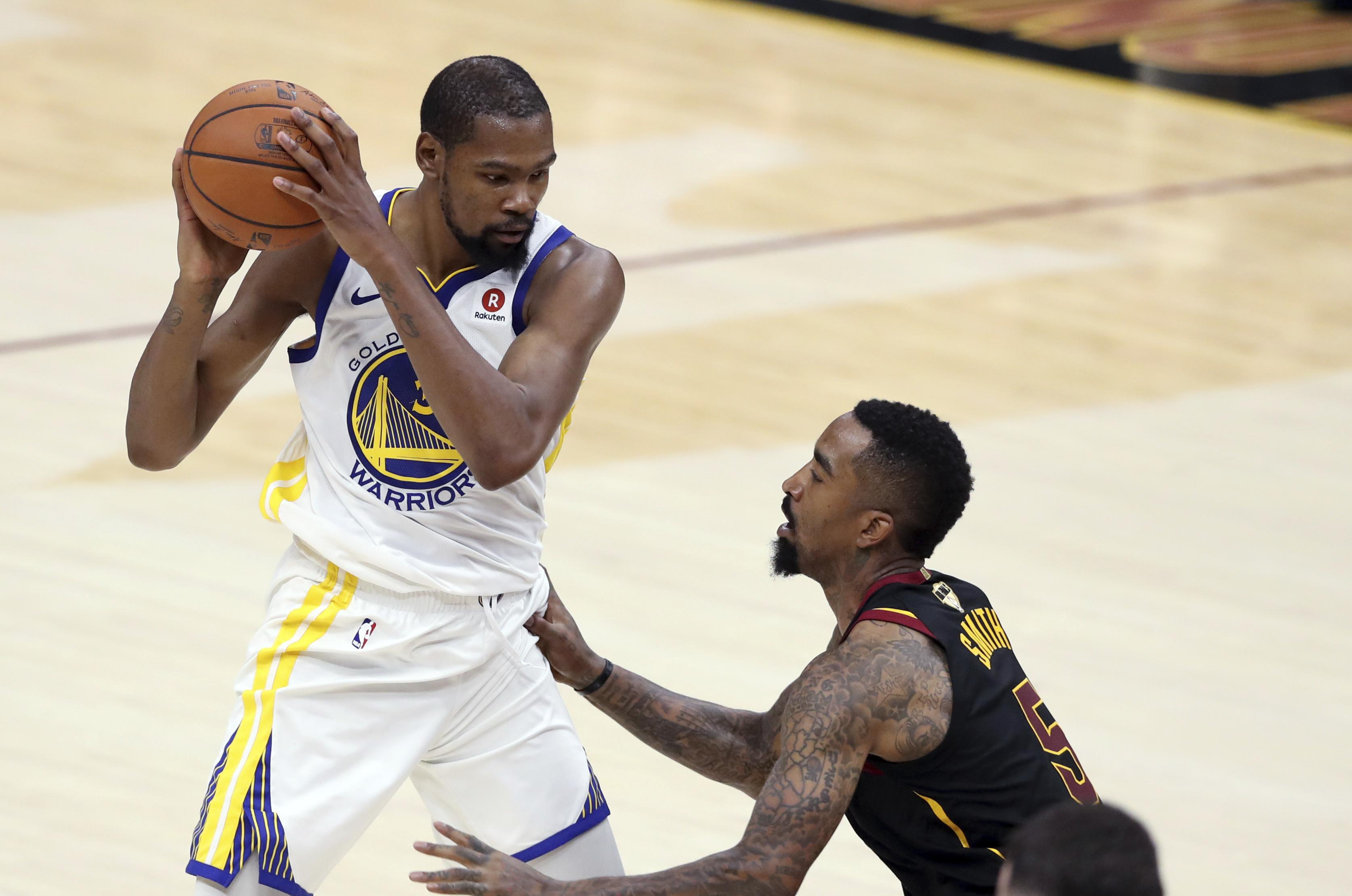 31ef222f74a Golden State Warriors  Kevin Durant is defended by Cleveland Cavaliers  JR  Smith during the