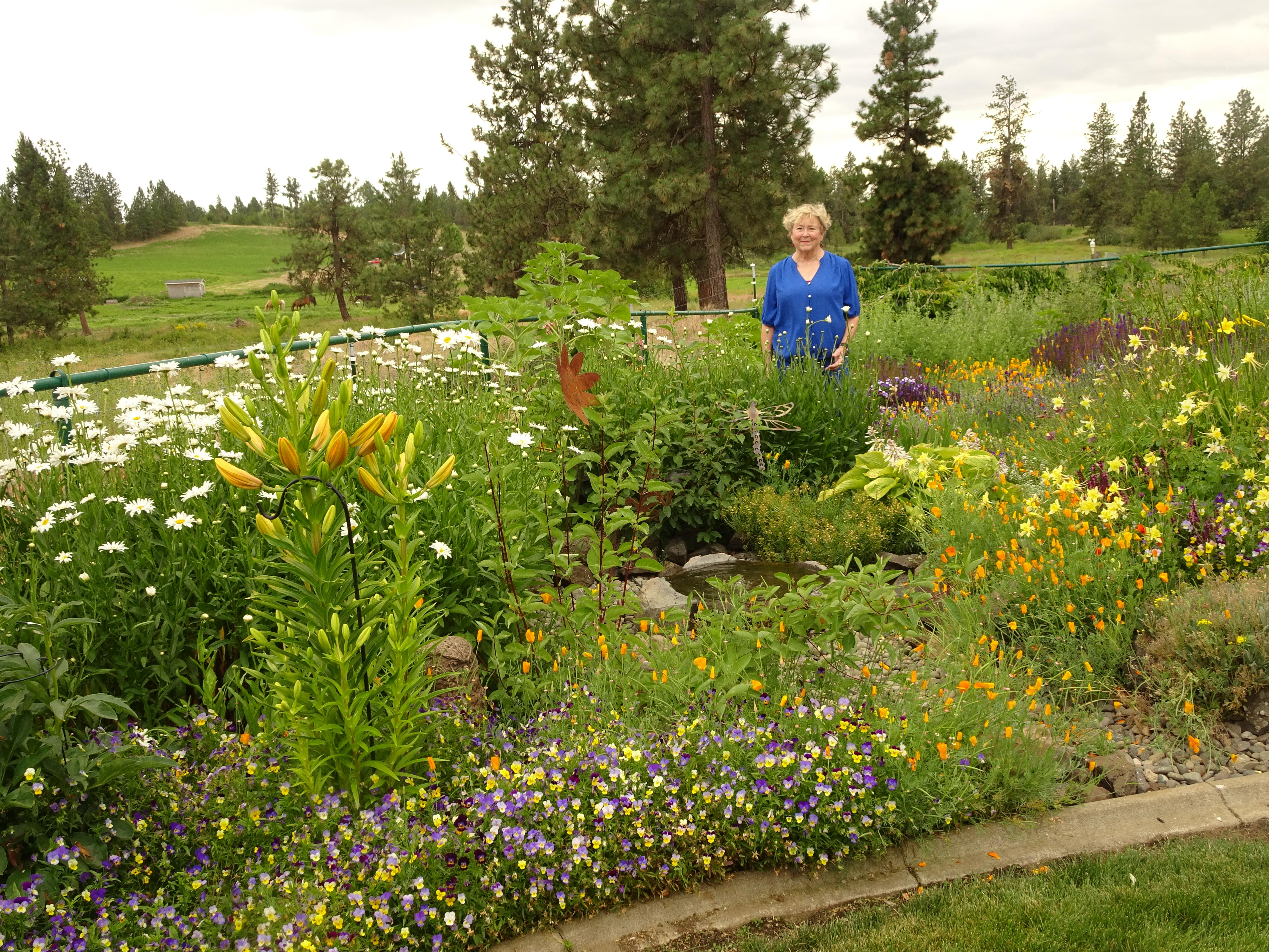 Carolyn Nesbitt Stands In Her Perennial Garden That Frames The Wild  Landscape Of The Channeled Scablands