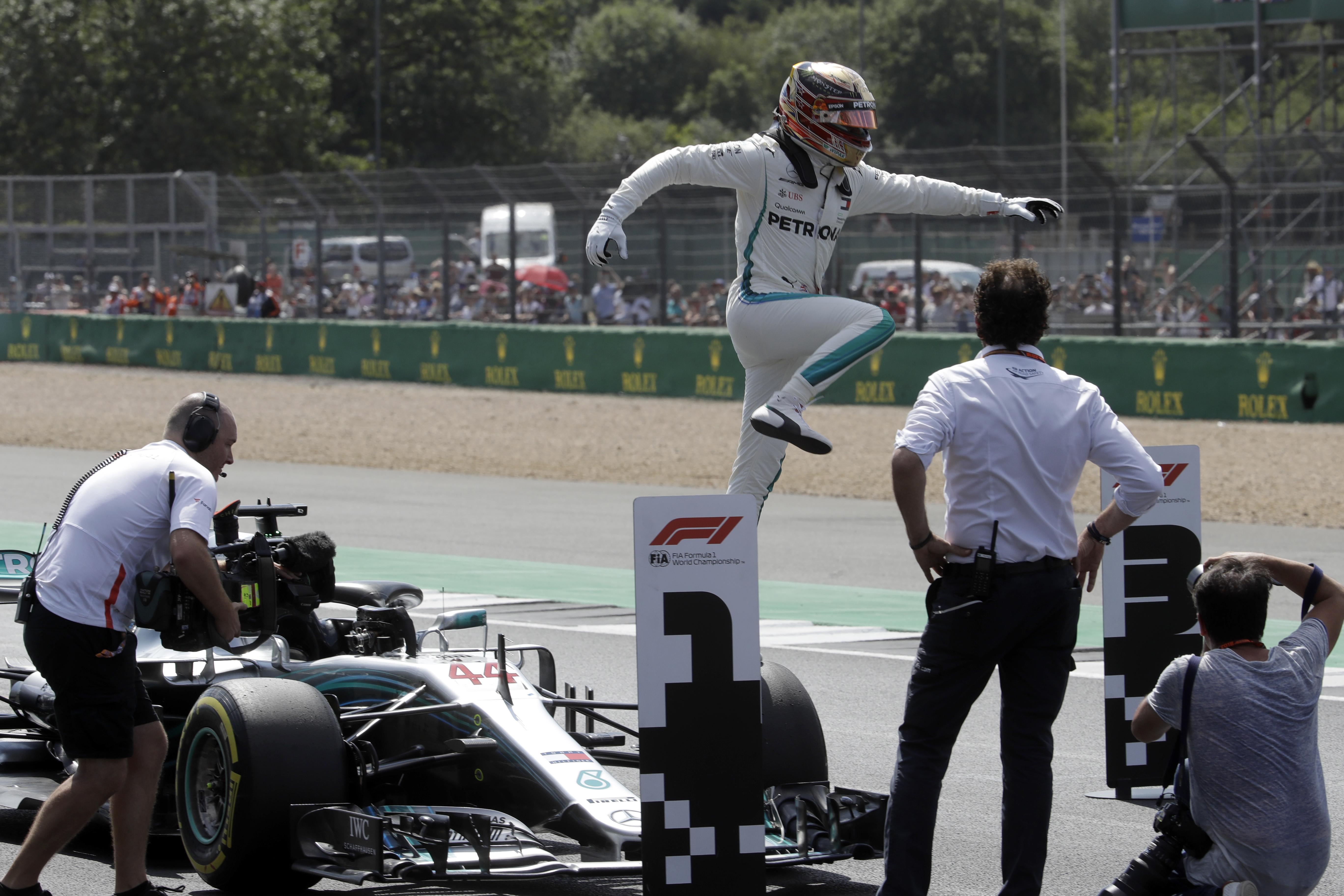 Mercedes driver Lewis Hamilton of Britain celebrates after getting the pole  position in the qualifying session 8d1104549d63