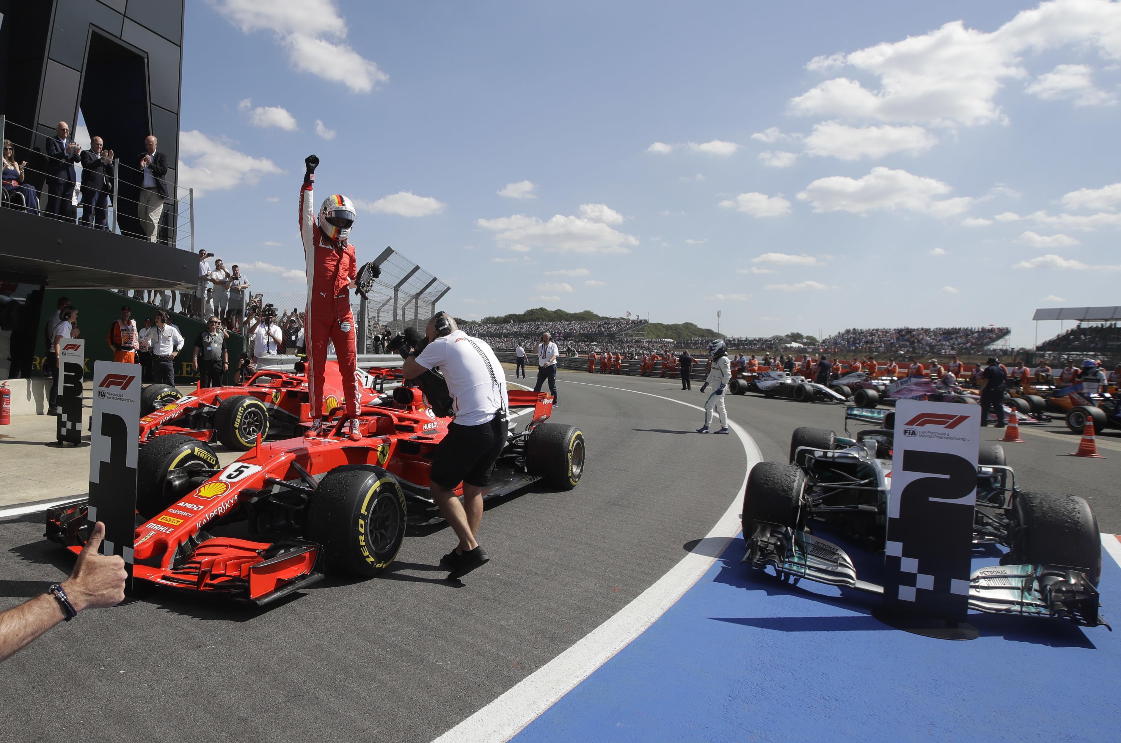 Ferrari driver Sebastian Vettel of Germany celebrates after winning the British  Formula One Grand Prix at a49812503889