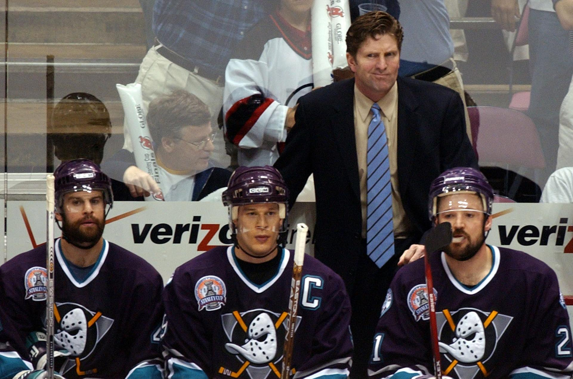 bbabfdceade Anaheim Mighty Ducks head coach Mike Babcock looks on with Rob Niedermayer,  left, Paul