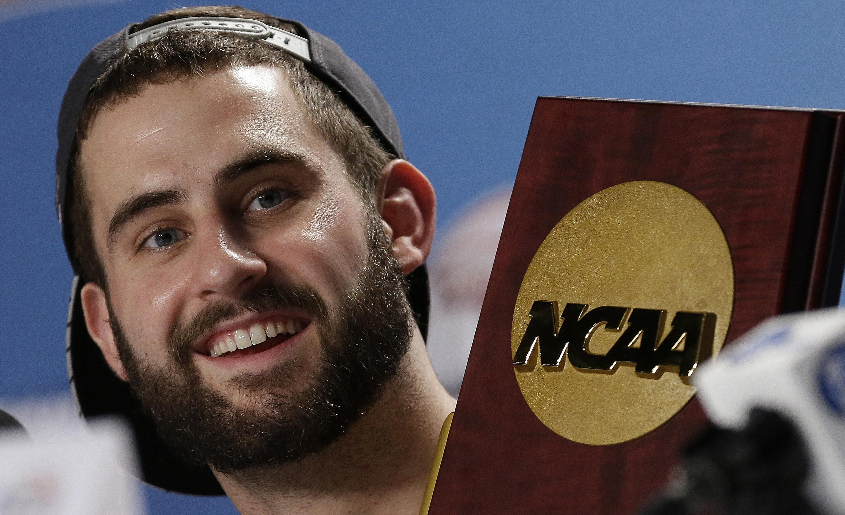 Ex-Louisville players sue NCAA over vacated national title
